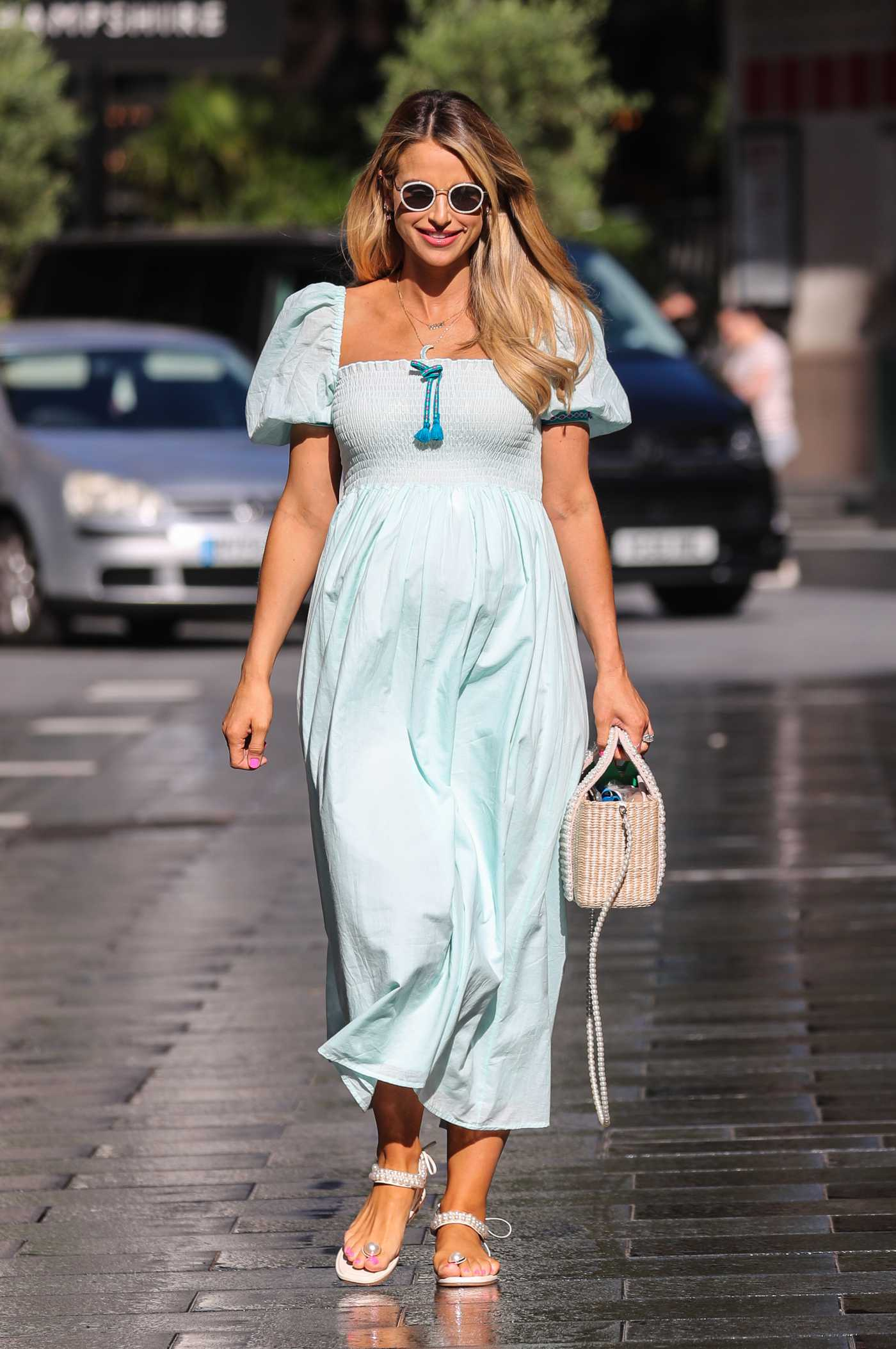 Vogue Williams in a Turquoise Maxi Dress Leaves the Heart Radio in London 07/12/2020