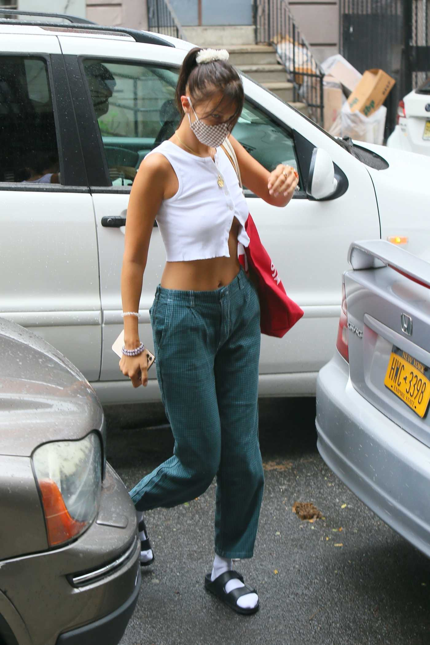 Bella Hadid in a White Top Visits a Friend in New York 08/13/2020