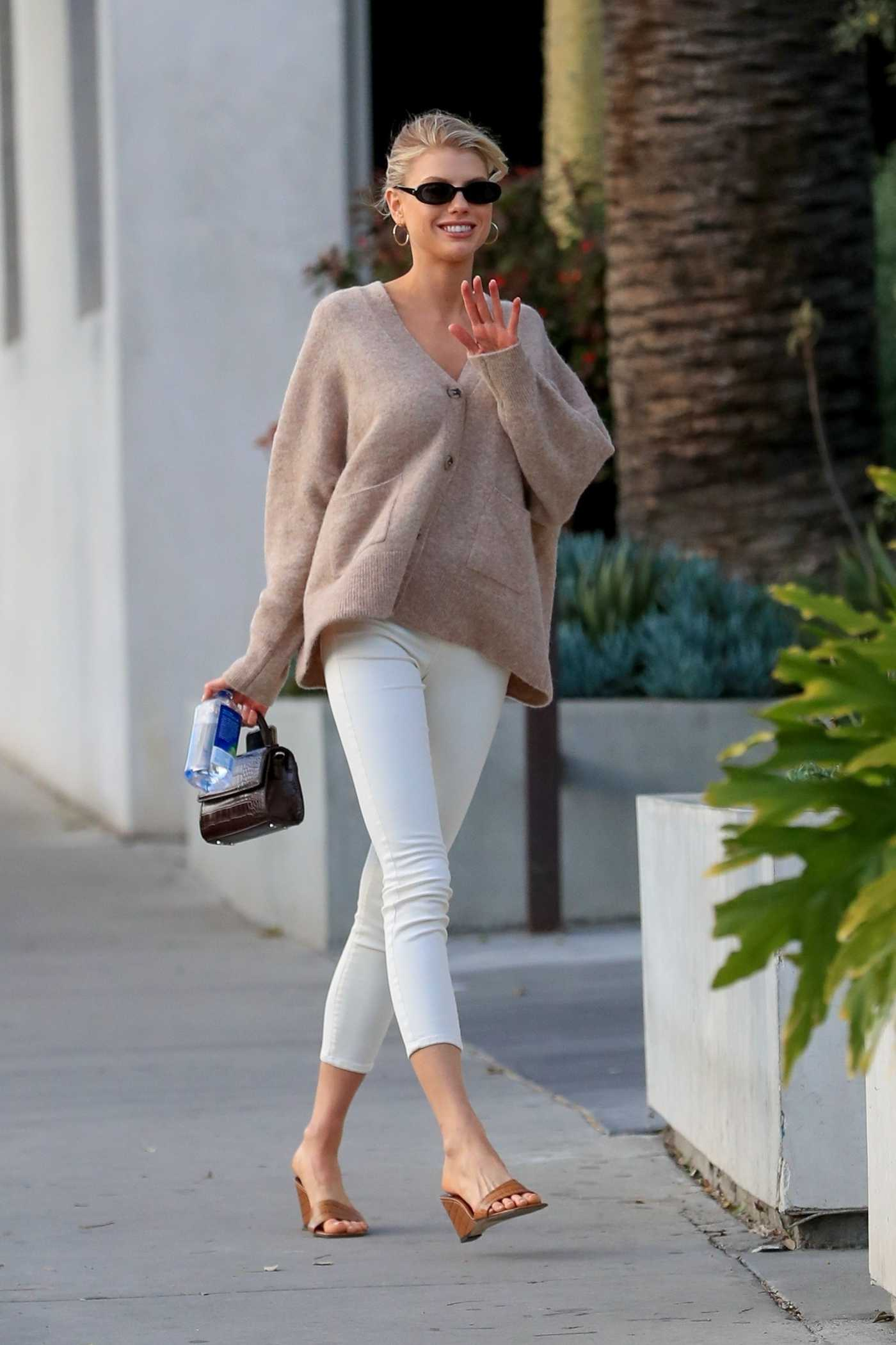 Charlotte McKinney in a Beige Cardigan Arrives at the Cha Cha Matcha in Los Angeles 08/11/2020