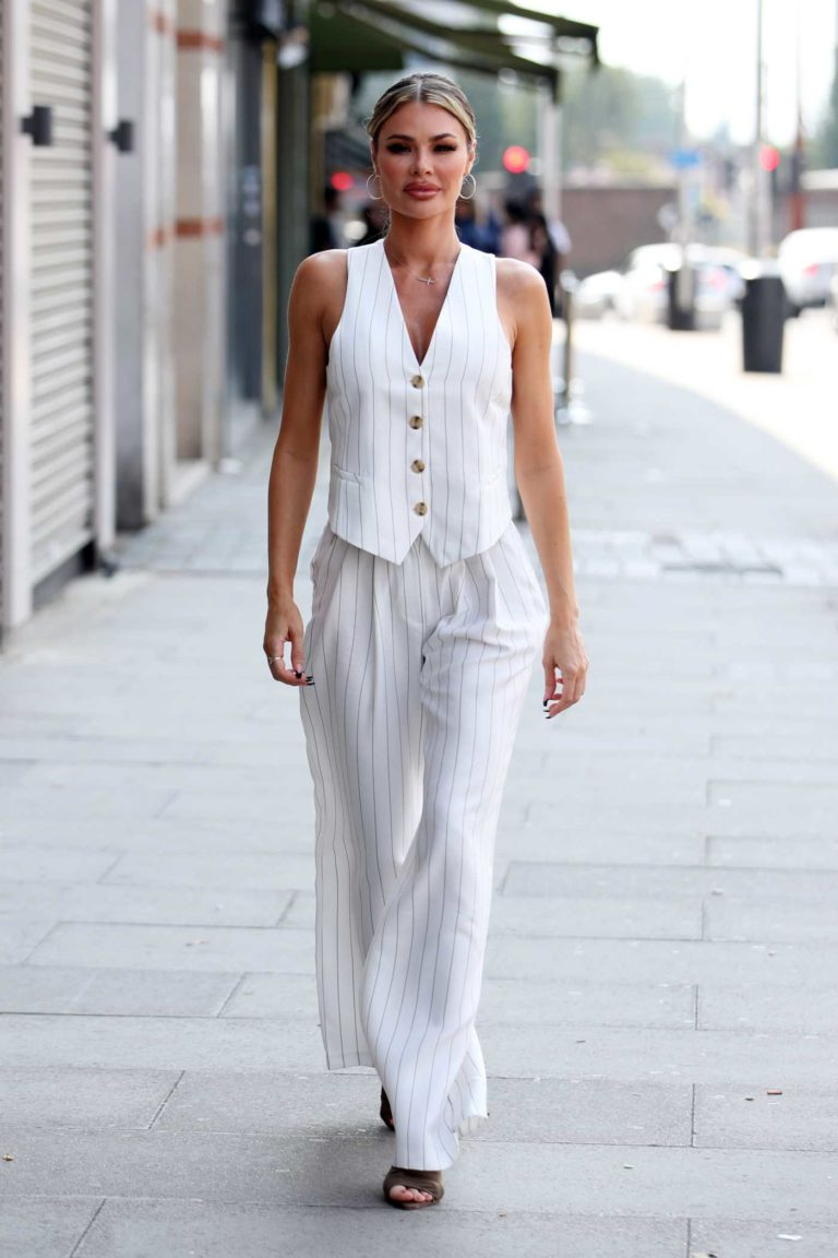 Chloe Sims in a White Striped Suit