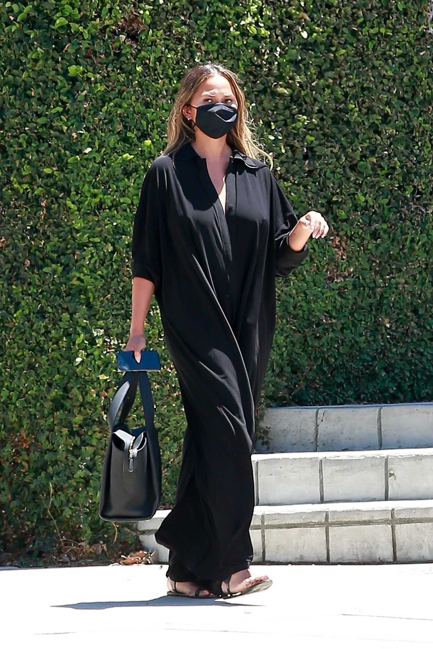 Chrissy Teigen in a Black Jumpsuit Was Seen Out in Los Angeles 07/31/2020