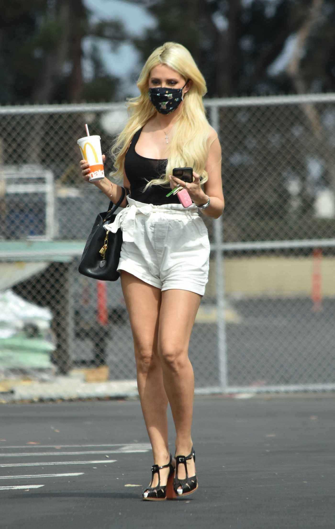 Holly Madison in a White Shorts Stops at a Studio in Los Angeles 08/24/2020