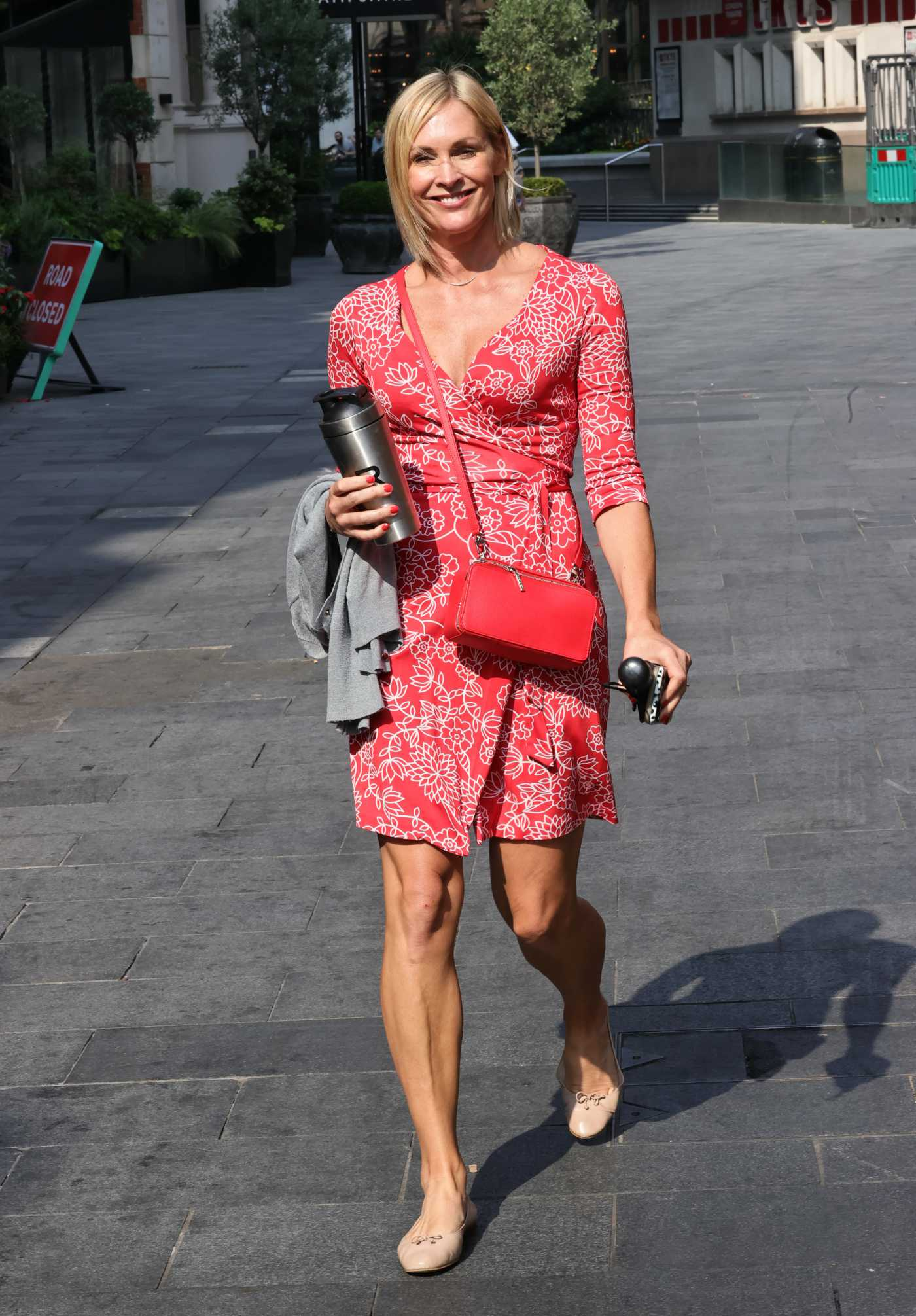 Jenni Falconer in a Red Summer Dress Arrives at the Smooth Radio in London 08/13/2020