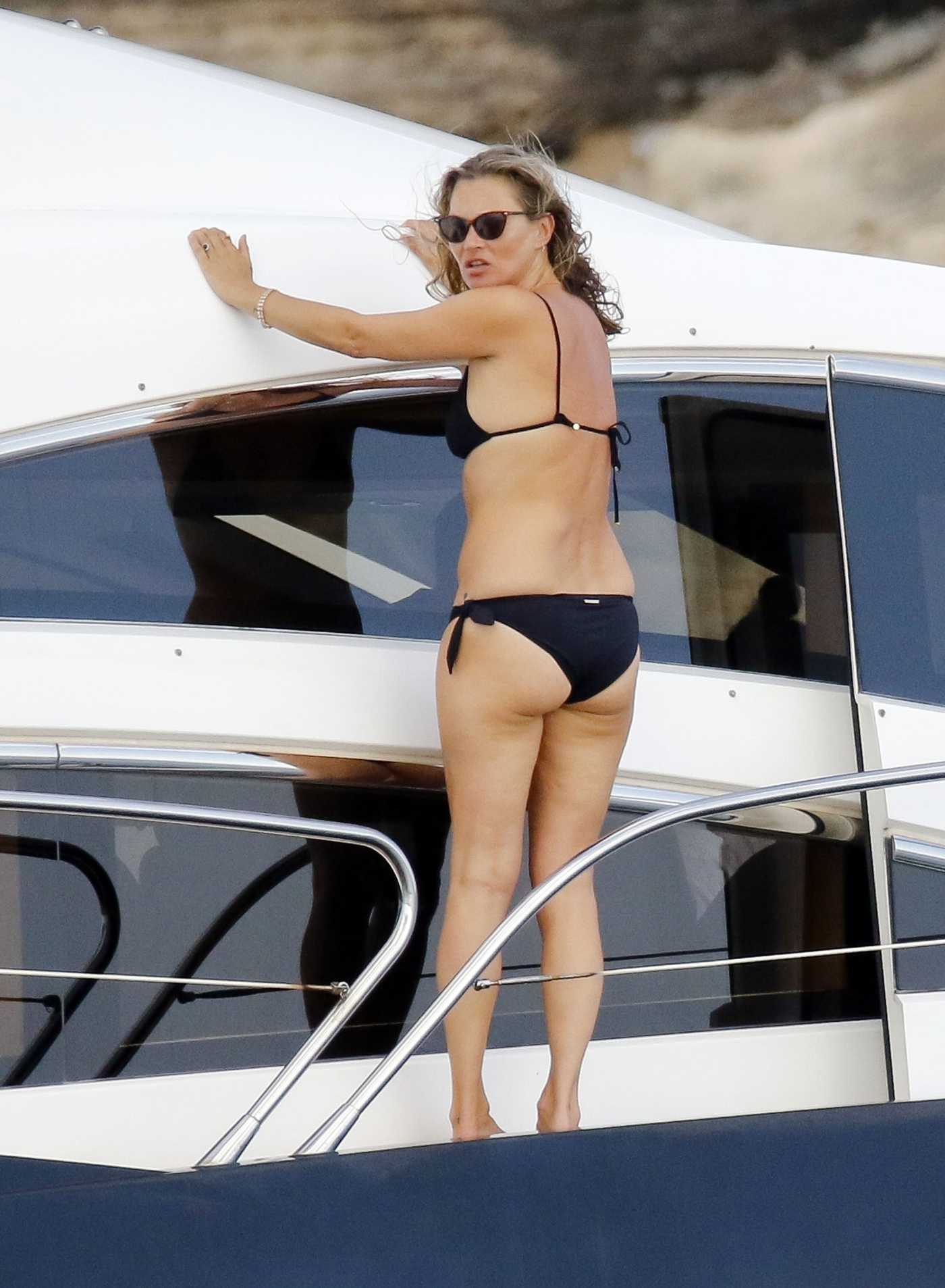 Kate Moss in a Black Bikini on Board of a Luxury Yacht in Ibiza 08/03/2020