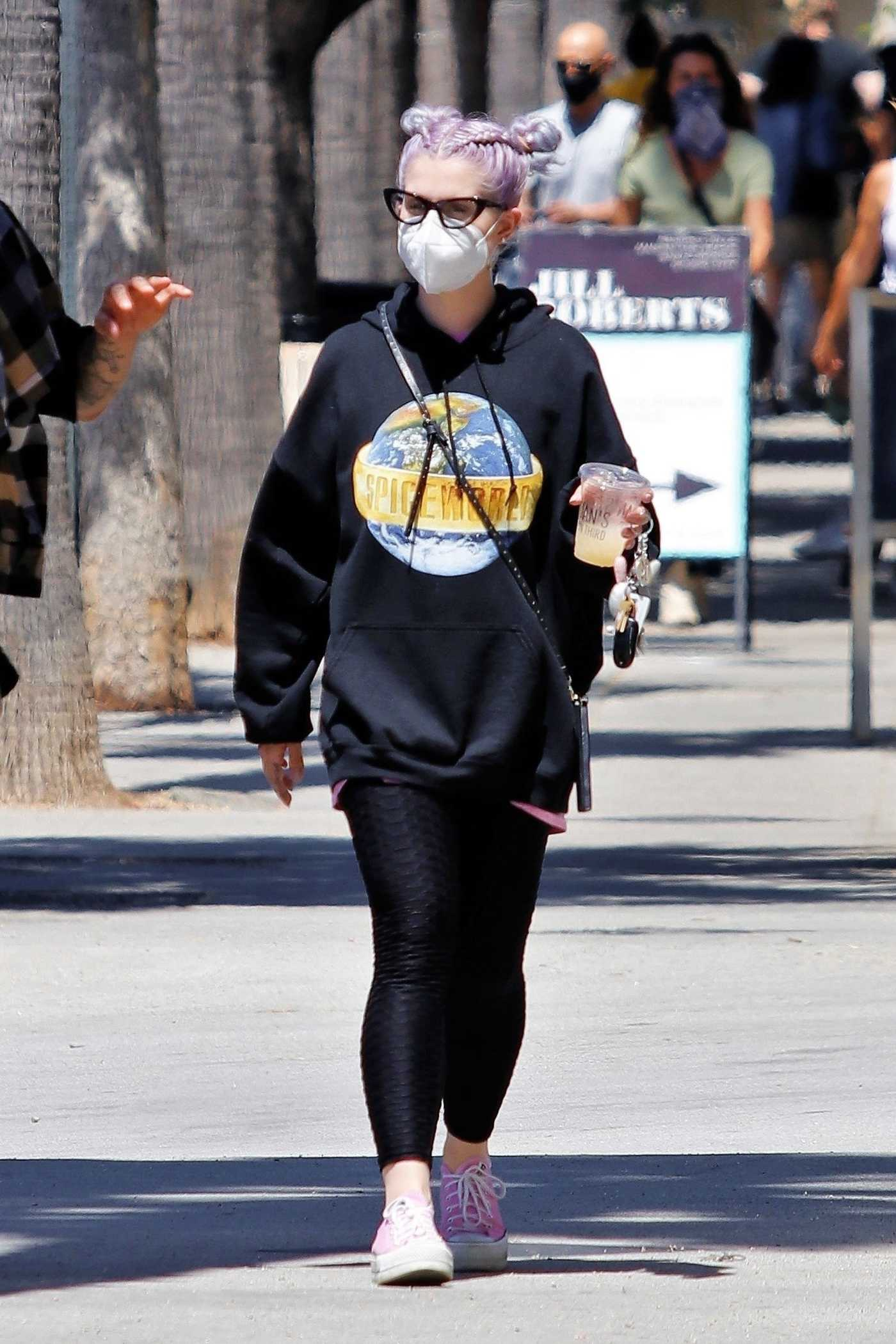 Kelly Osbourne in a Black Hoody Exits Joan's on Third in Los Angeles 08/08/2020
