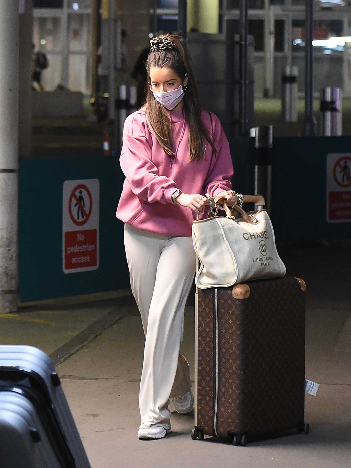 Maura Higgins in a Pink Hoody Arrives at Gatwick Airport in London 08/18/2020