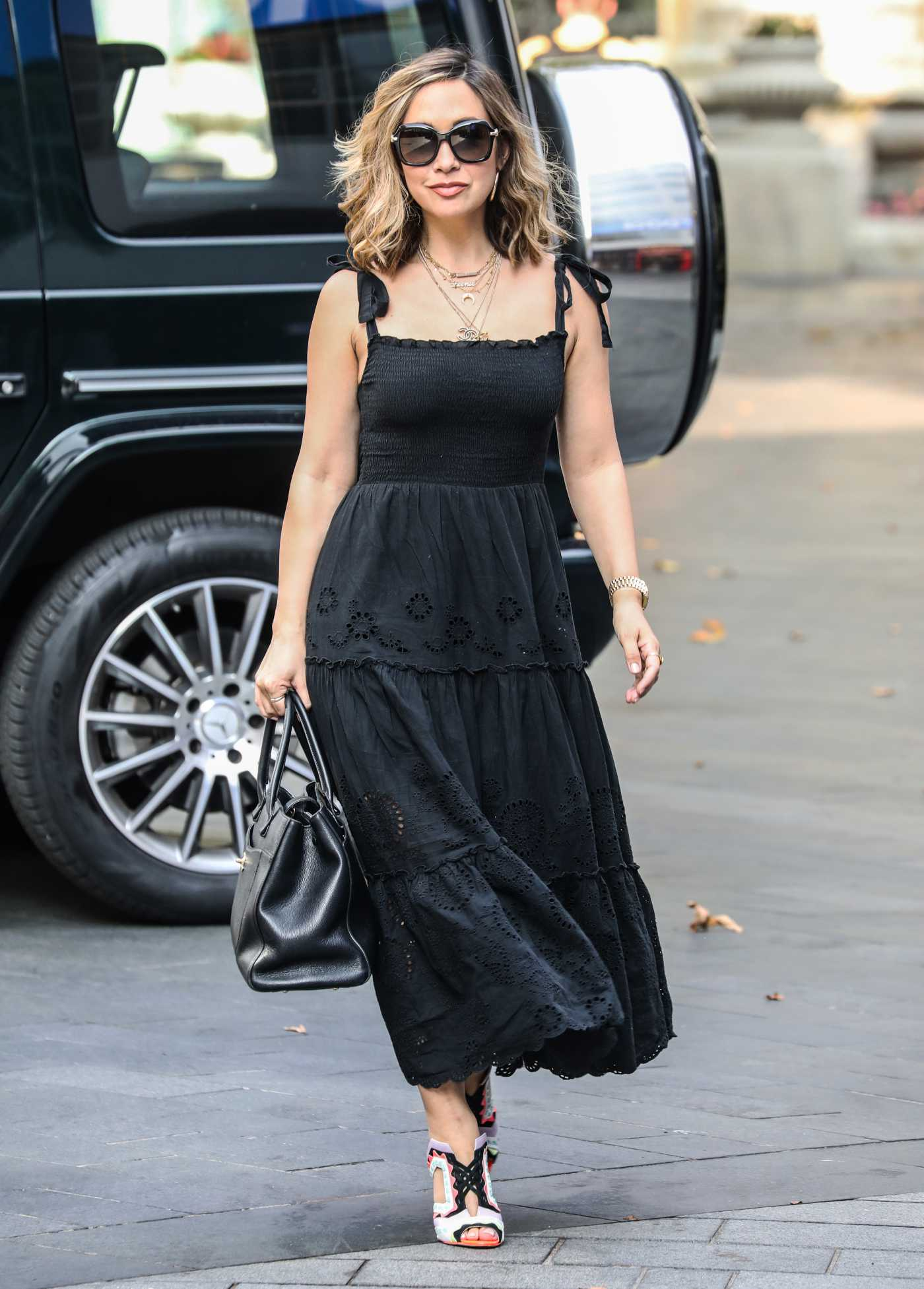 Myleene Klass in a Black Dress Arrives at the Global Radio Studios in London 08/13/2020