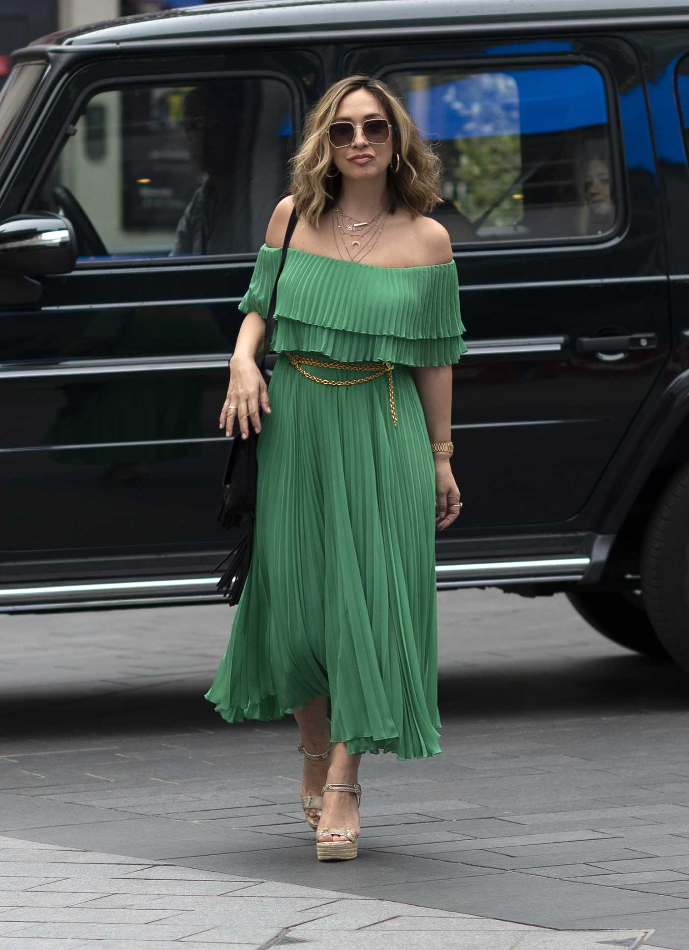 Myleene Klass in a Green Strapless Dress Arrives at the Smooth Radio in London 08/14/2020