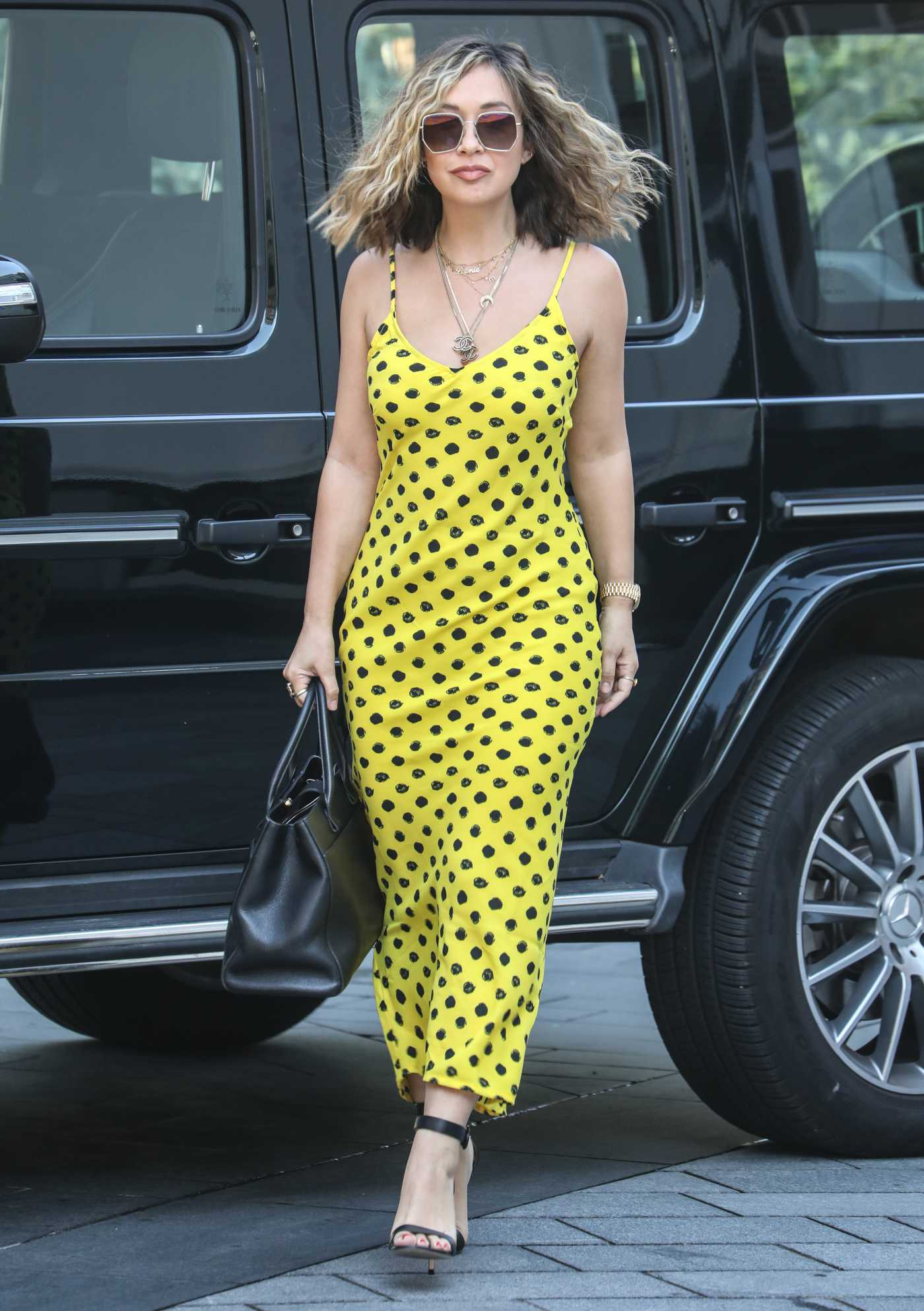 Myleene Klass in a Yellow Polka Dot Sundress Arrives at the Global Radio Studios in London 07/31/2020
