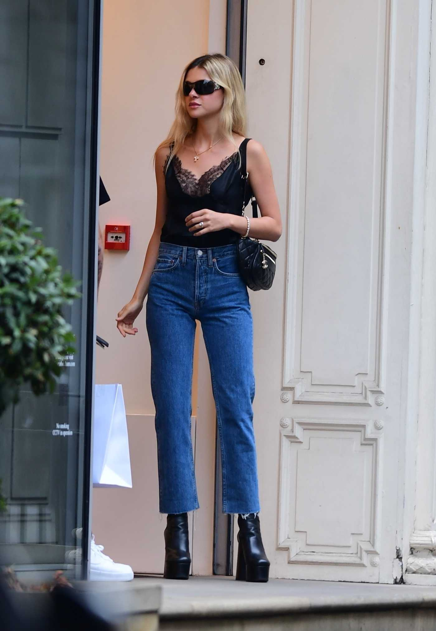 Nicola Peltz in a Black Top Leaves the Victoria Beckham Store on Dover Street in Central London 08/15/2020