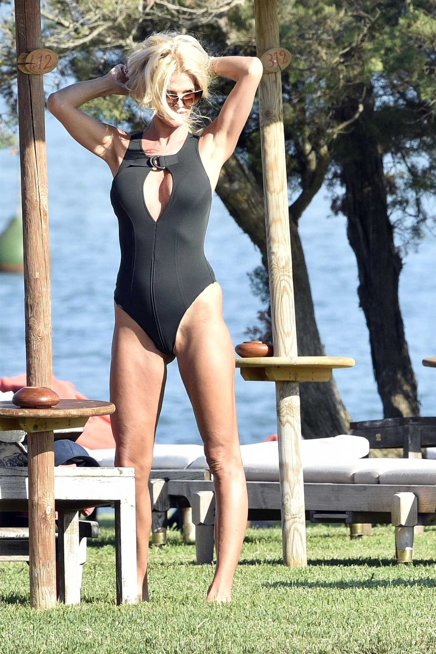 Victoria Silvstedt in a Black Swimsuit by the Pool at the Luxury Hotel Cala di Volpe in Porto Cervo 08/19/2020