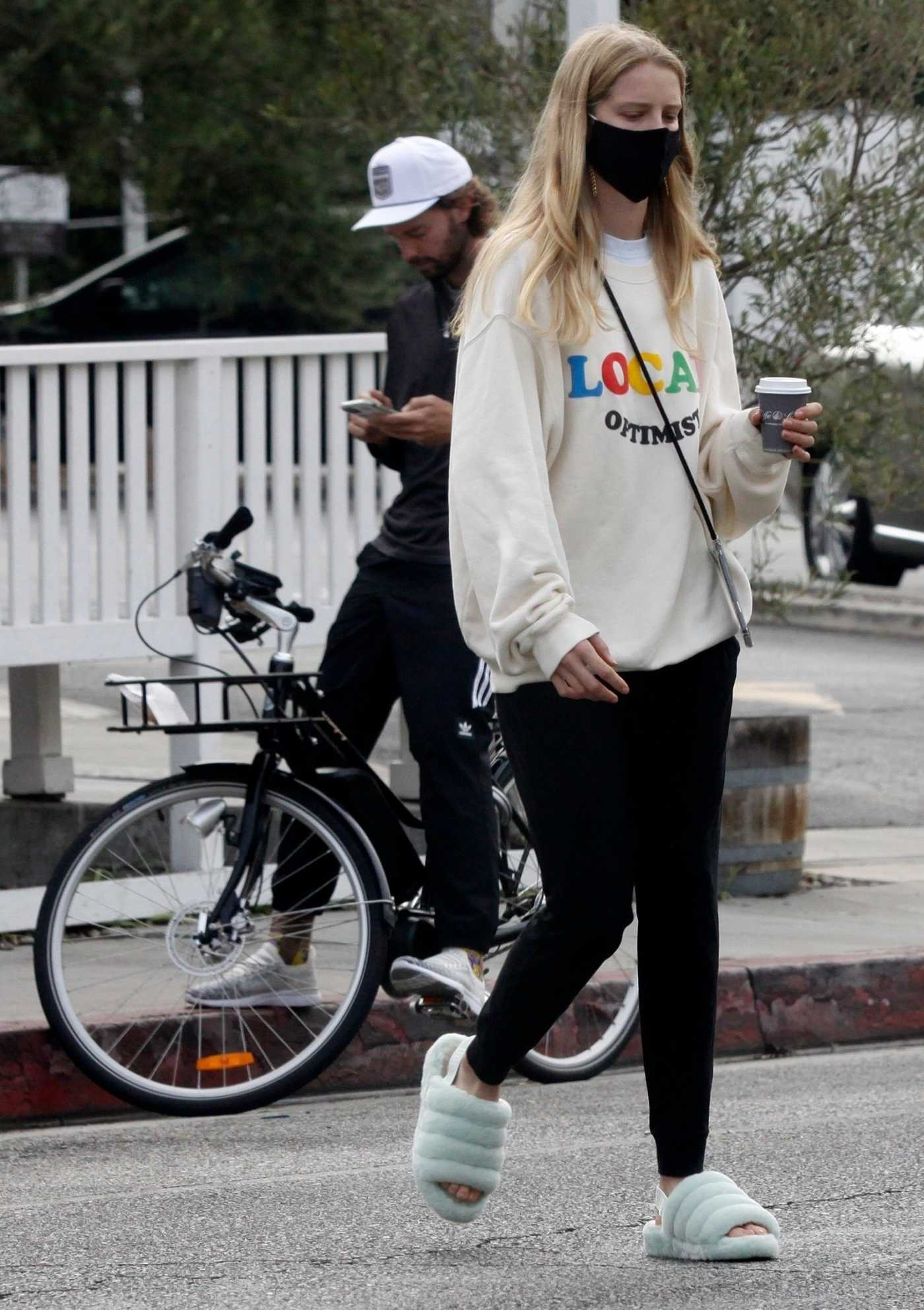Abby Champion in a White Sweatshirt Does a Bike Ride Out with Patrick Schwarzenegger in Los Angeles 08/31/2020