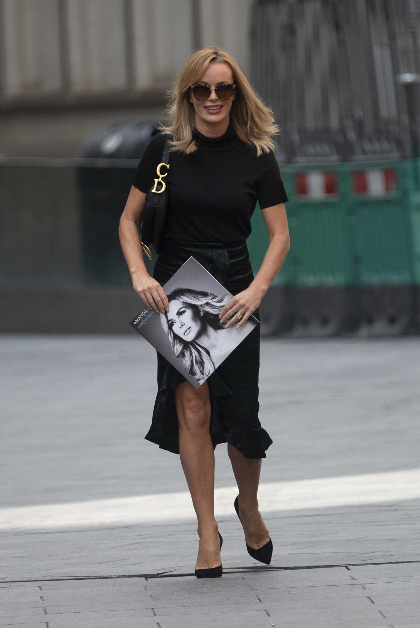 Amanda Holden in a Black Skirt Arrives at the Global Radio Studios in London 09/03/2020