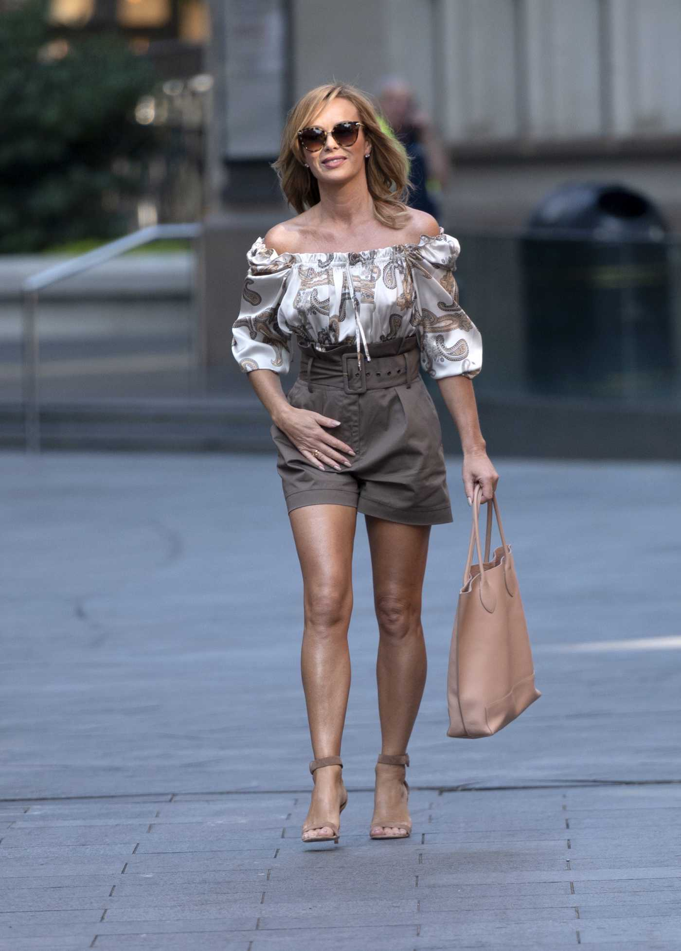 Amanda Holden in a Brown Shorts Arrives at the Global Radio Studios in London 09/14/2020