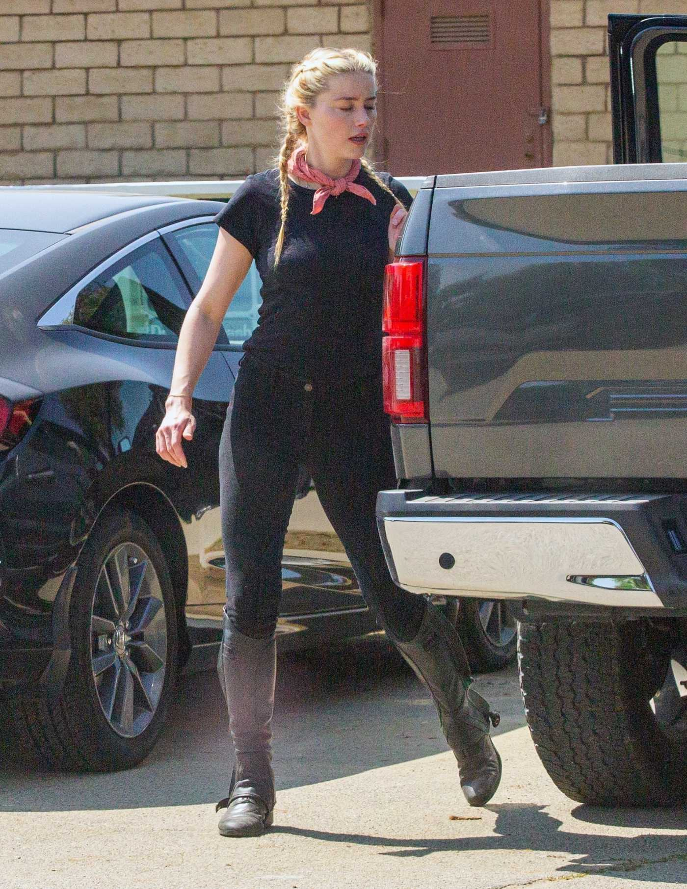 Amber Heard in a Black Tee Arrives at Horseback Riding in Los Angeles 09/23/2020