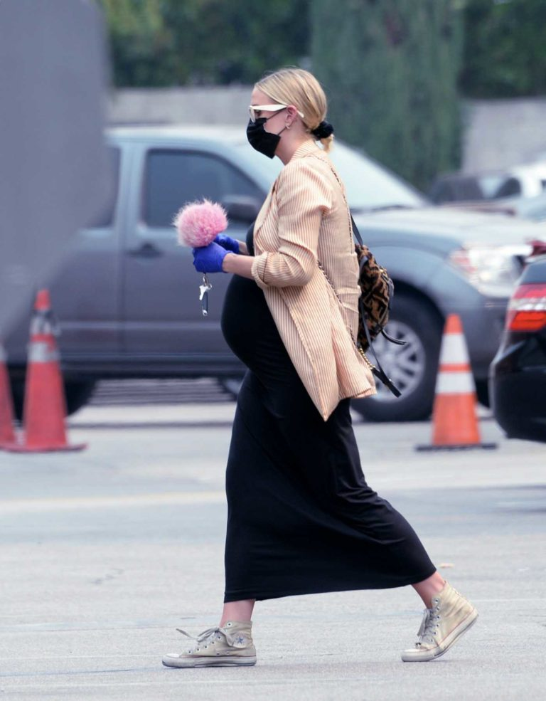 Ashlee Simpson in a Black Protective Mask