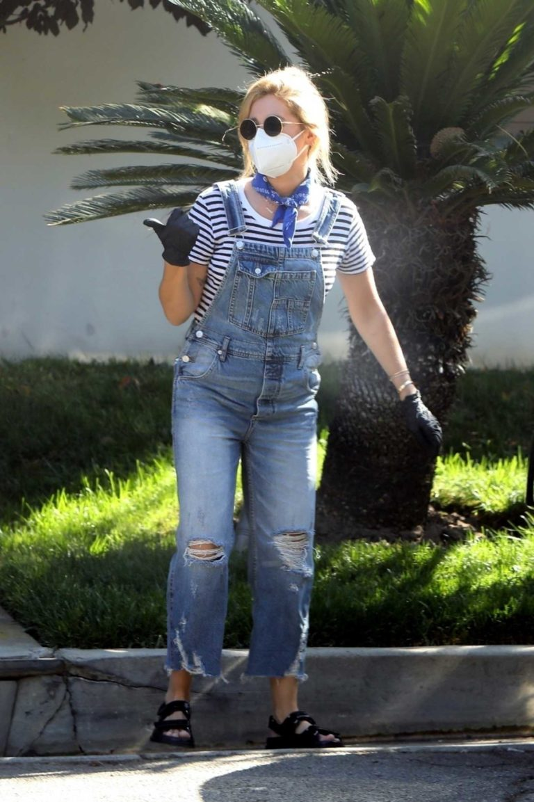 Ashley Tisdale in a Blue Ripped Jumpsuit