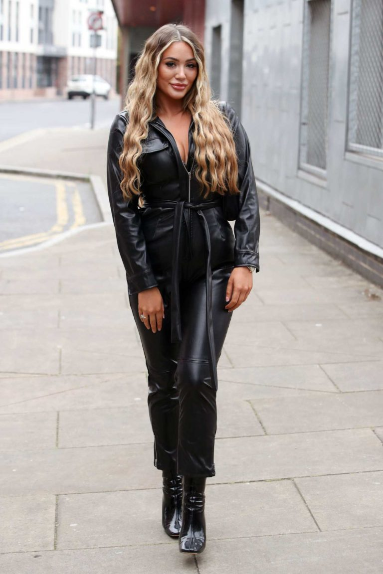 Frankie Sims in a Black Leather Jumpsuit