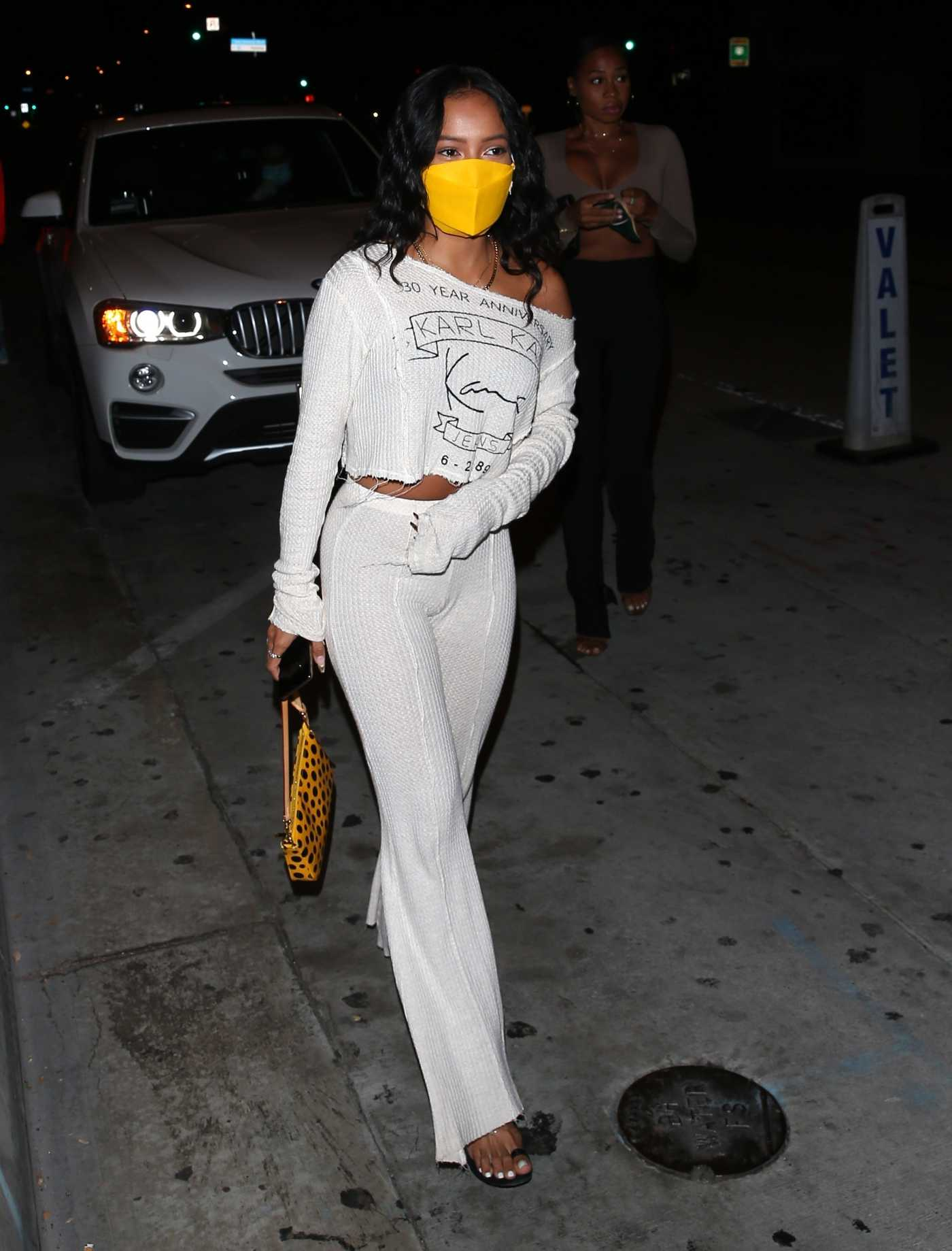 Karrueche Tran in a Yellow Protective Mask Arrives to Dinner at Catch Restaurant in West Hollywood 09/13/2020