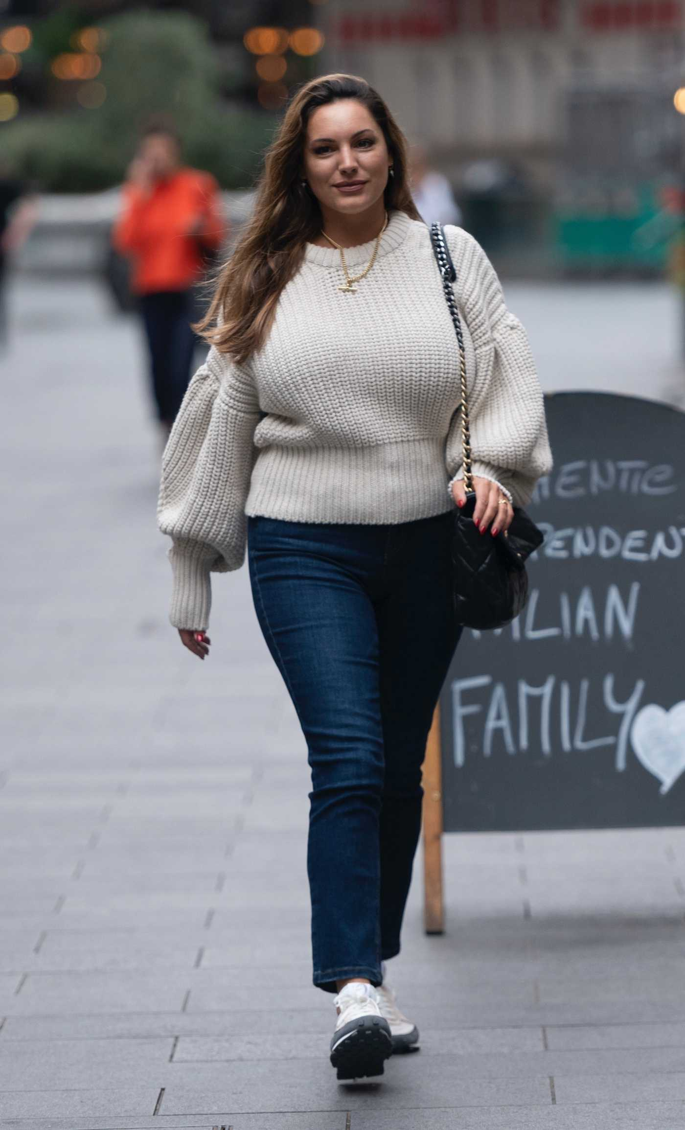 Kelly Brook in a Beige Sweater Arrives at the Global Radio in London 09/23/2020