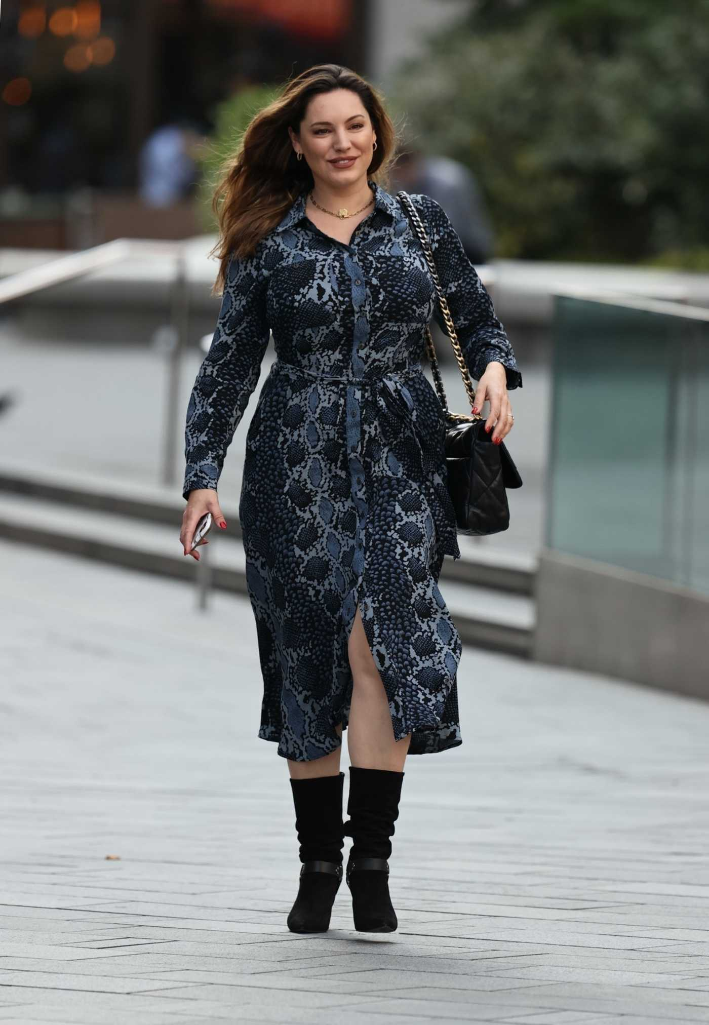 Kelly Brook in a Snakeskin Patterned Dress Arrives at the Heart Radio Studios in London 09/11/2020