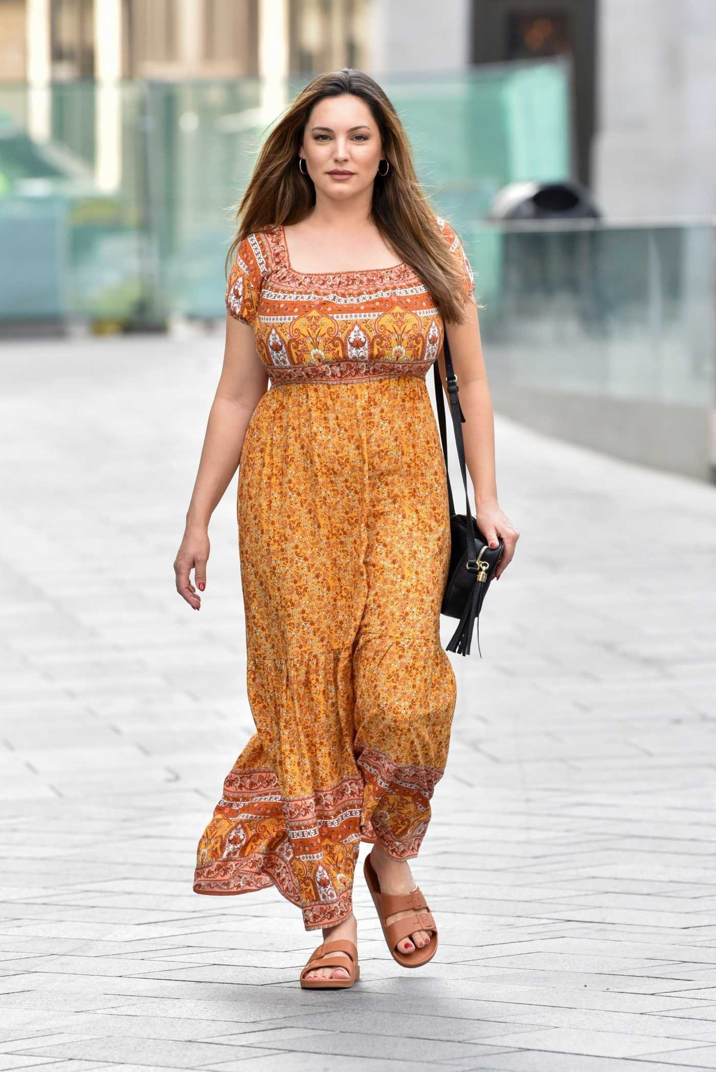 Kelly Brook in a Yellow Floral Dress Arrives at the Global Radio Studios in London 09/15/2020