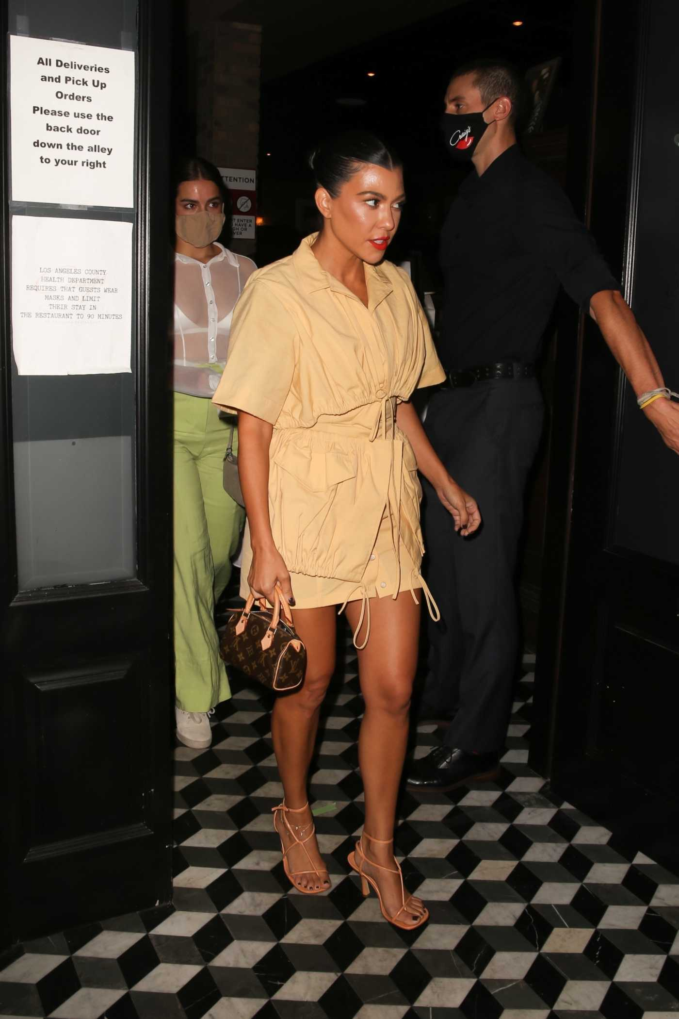 Kourtney Kardashian in a Yellow Dress Leaves Dinner at Craigs in West Hollywood 09/15/2020