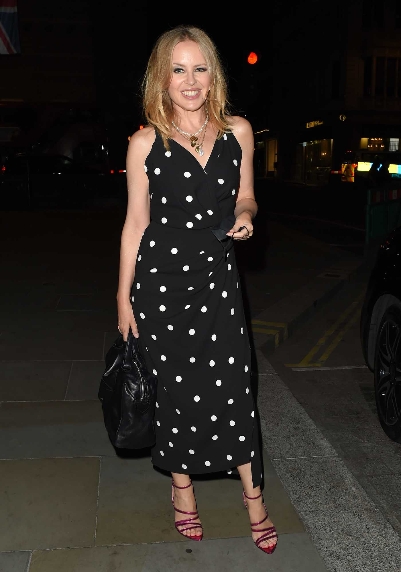 Kylie Minogue in a Black Polka Dot Dress Enjoys a Night Out at the Ritz Hotel in Mayfair, London 09/21/2020
