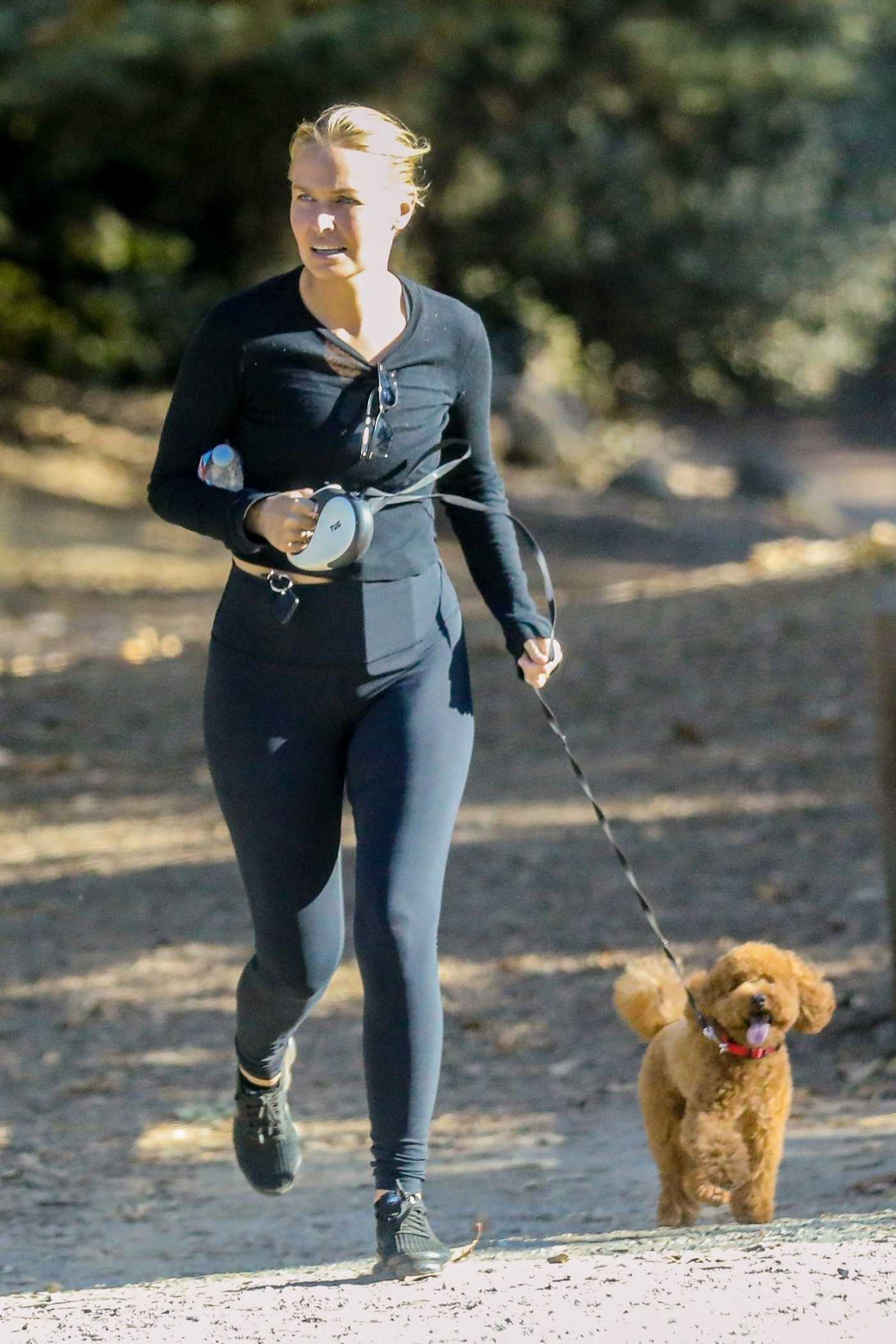 Lara Bingle in a Black Leggings Walks Her Puppy in Hollywood Hills 09/27/2020
