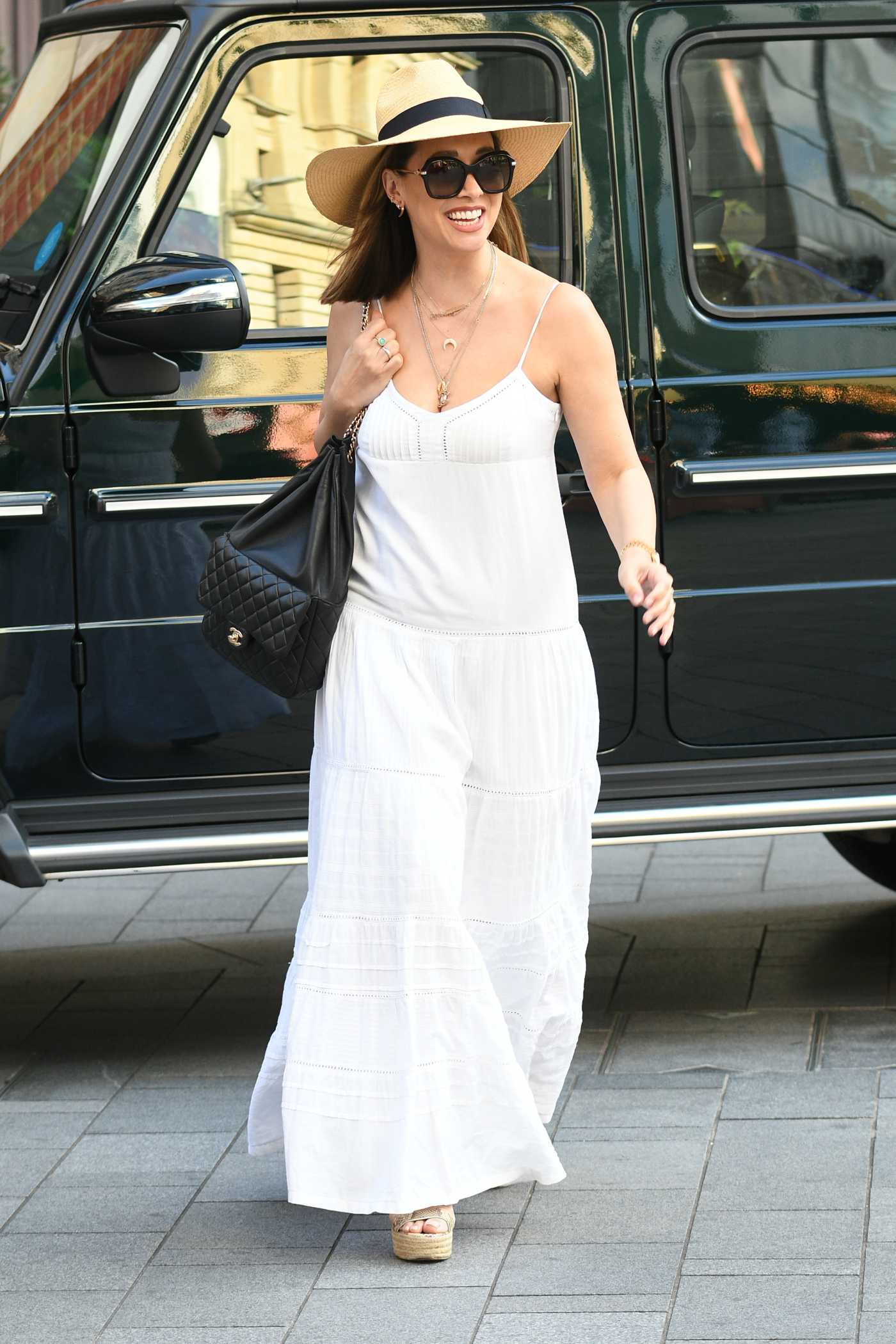 Myleene Klass in a White Summer Dress Arrives at the Global Radio Studios in London 09/05/2020