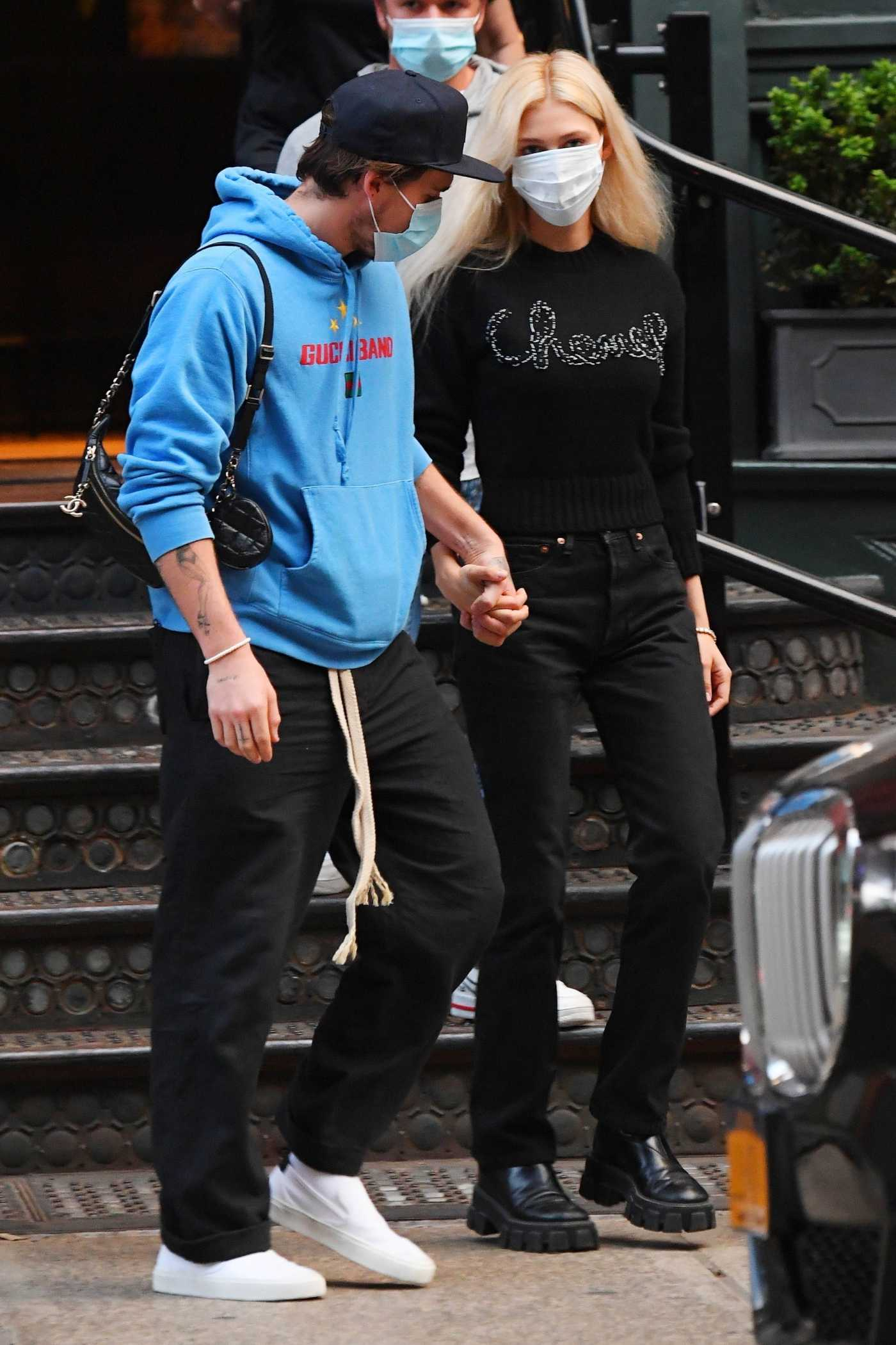 Nicola Peltz in a Protective Mask Was Seen Out with Brooklyn Beckham in Soho, New York 09/24/2020