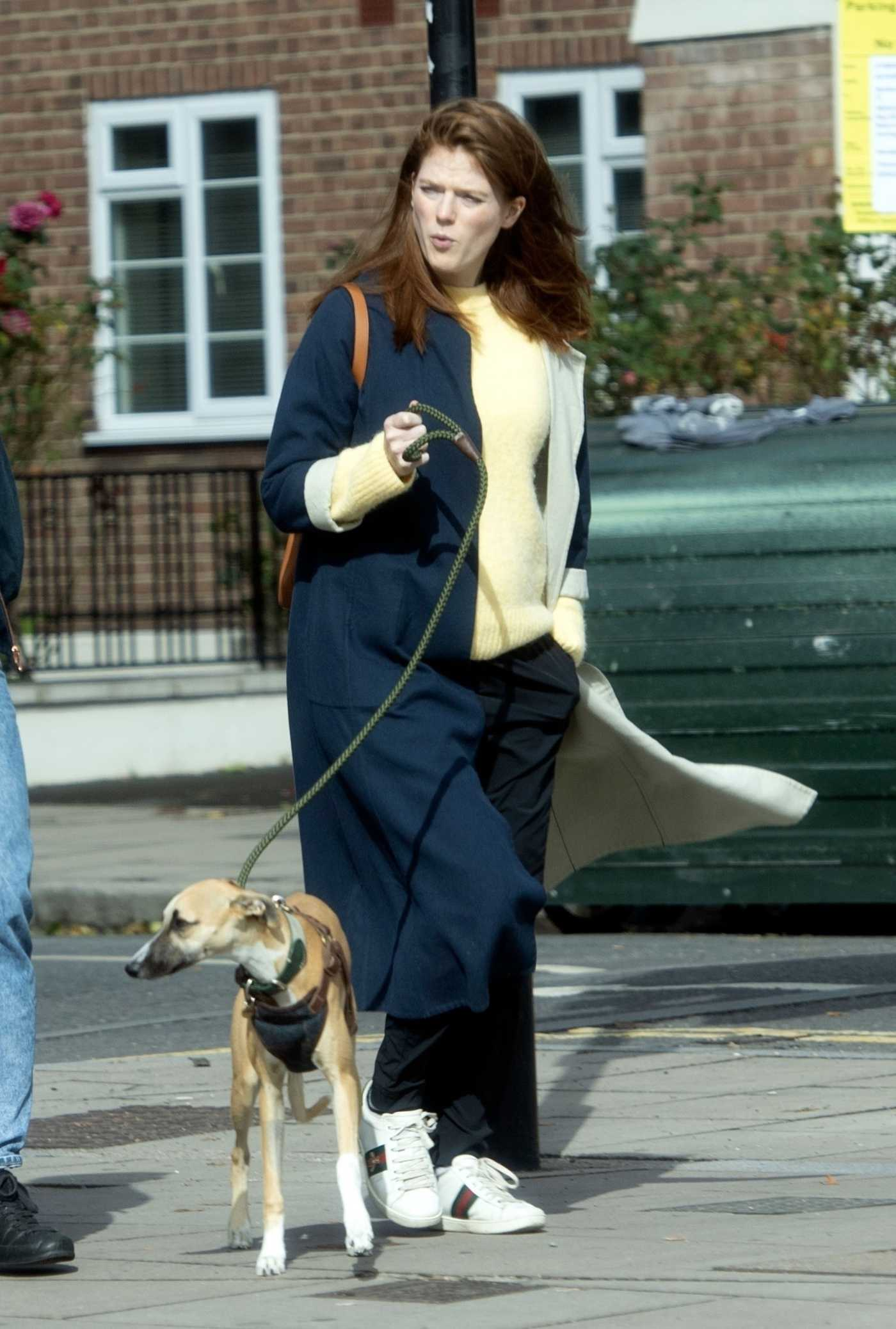 Rose Leslie in a Black Coat Walks Her Dog Out with Kit Harington in London 09/25/2020