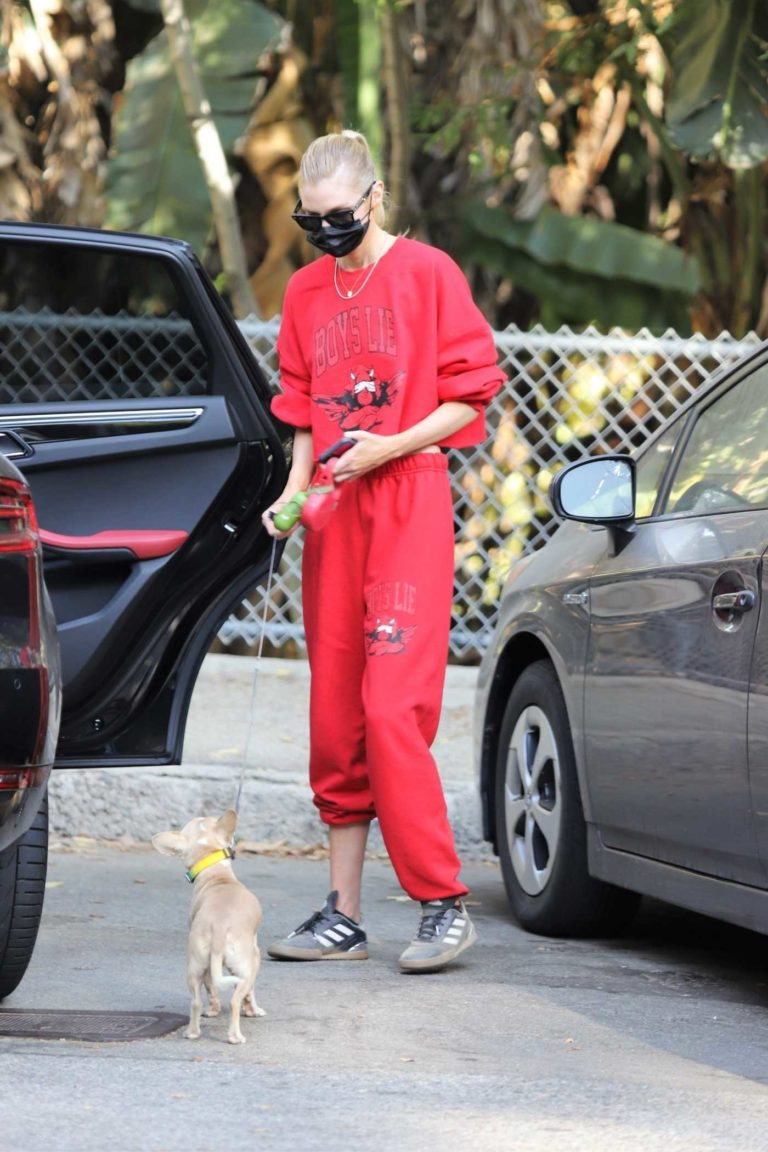 Stella Maxwell in a Red Sweatsuit