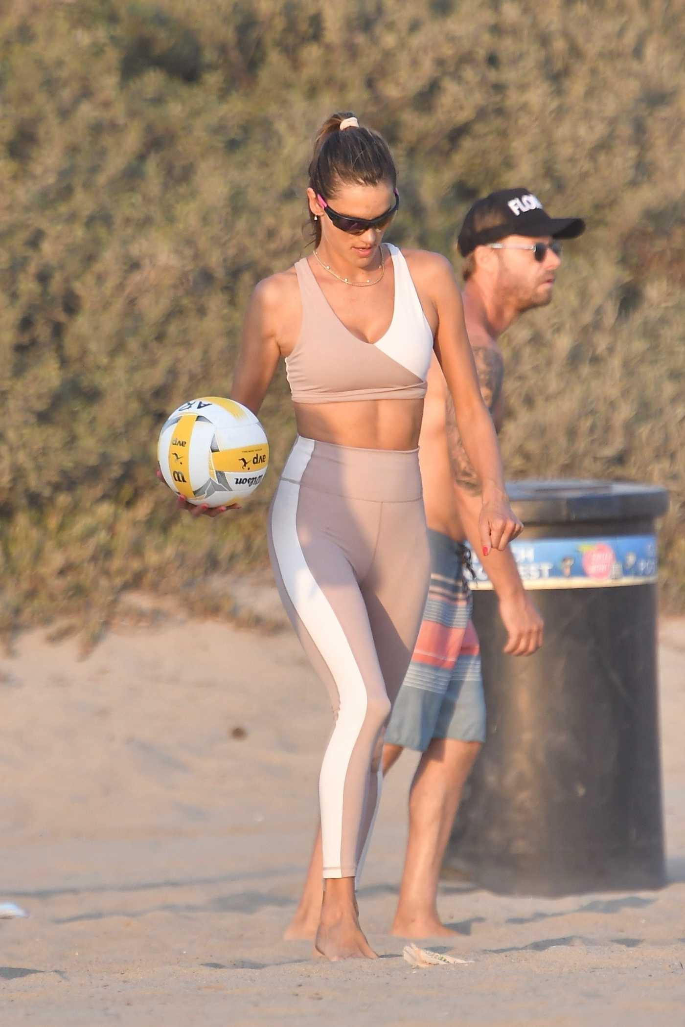 Alessandra Ambrosio in a Beige Workout Ensemble Plays Volleyball with Friends on the Beach in Santa Monica 10/01/2020
