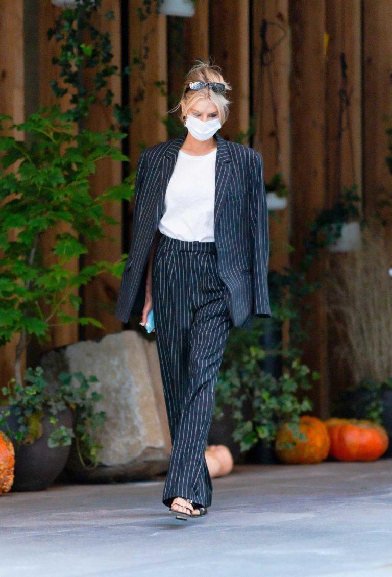 Charlotte McKinney in a Black Striped Suit