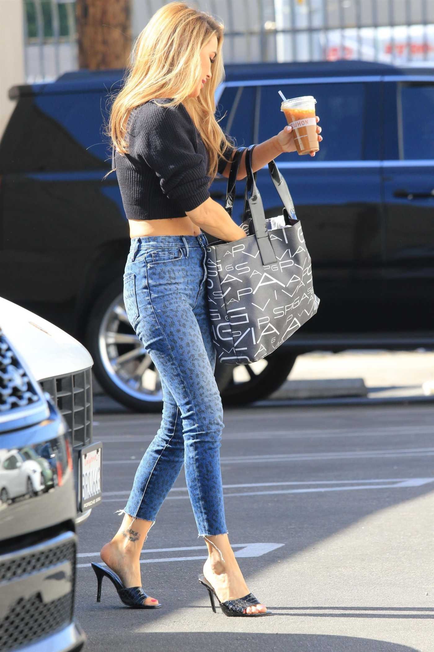 Chrishell Stause in a Blue Animal Print Jeans Arrives at the DWTS Studio in Los Angeles 10/30/2020