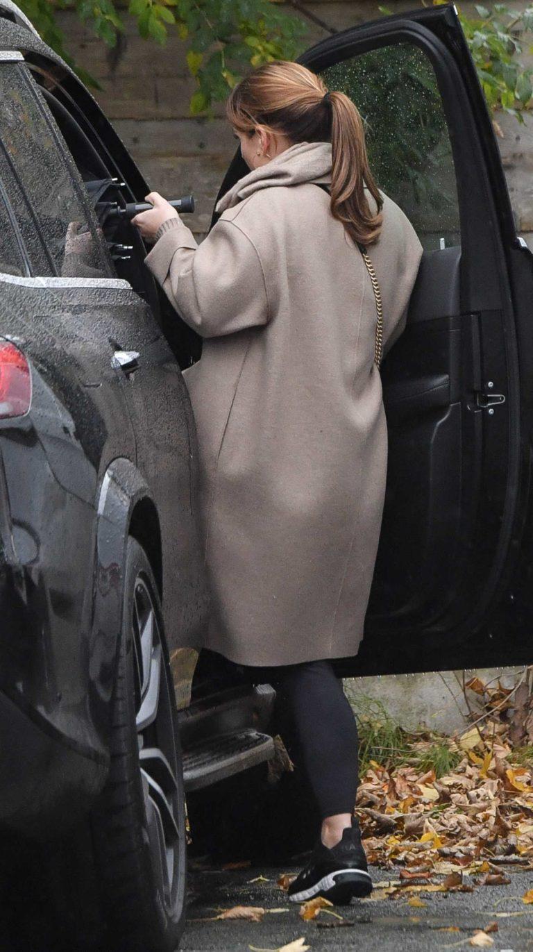 Coleen Rooney in a Beige Coat