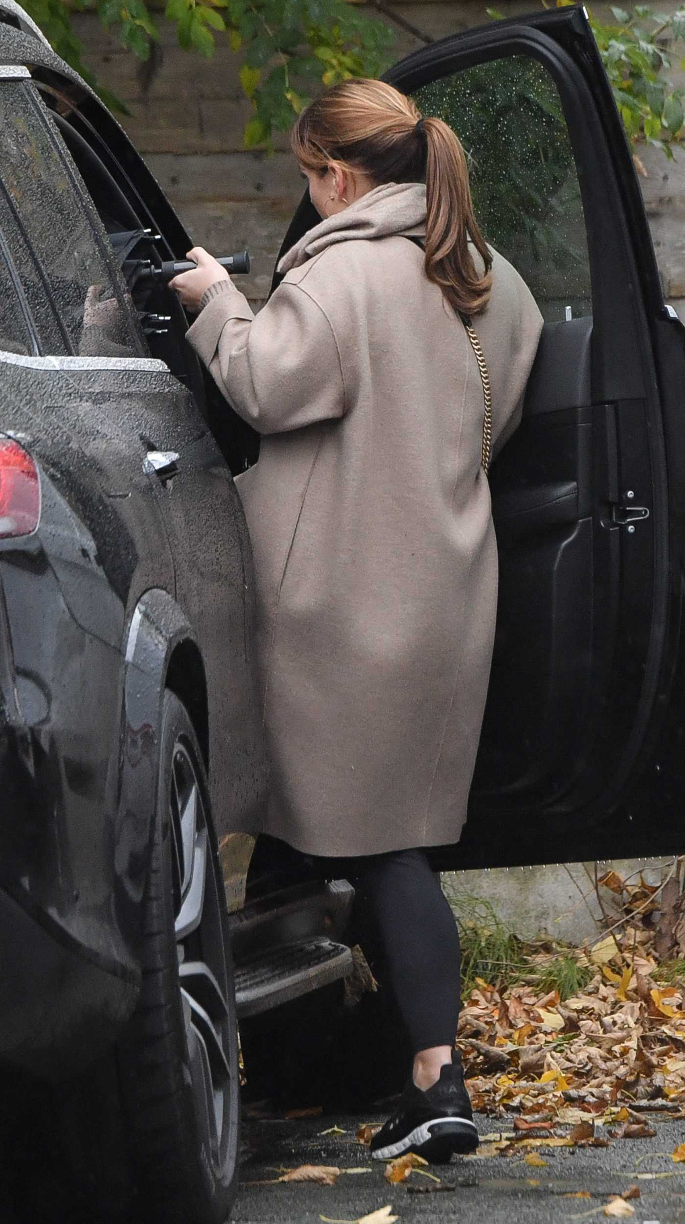 Coleen Rooney in a Beige Coat Loads up Boxes Out in Alderley Edge in Cheshire 10/23/2020