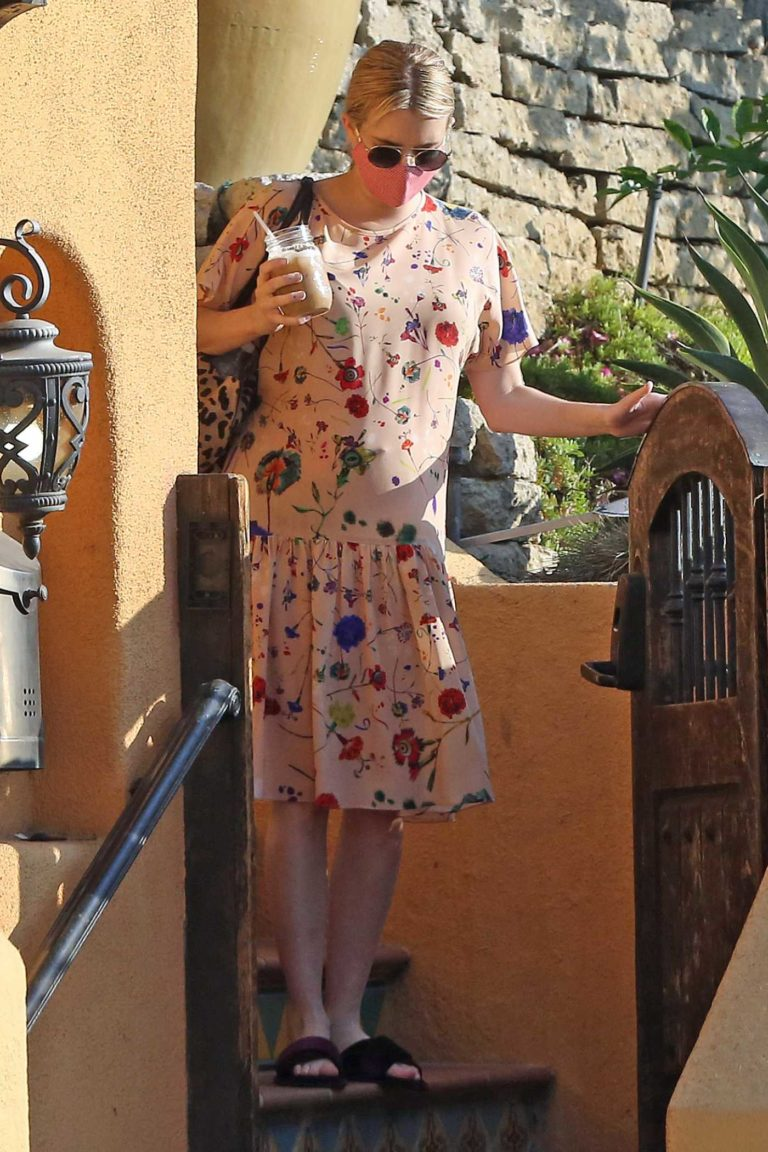 Emma Roberts in a Beige Floral Dress
