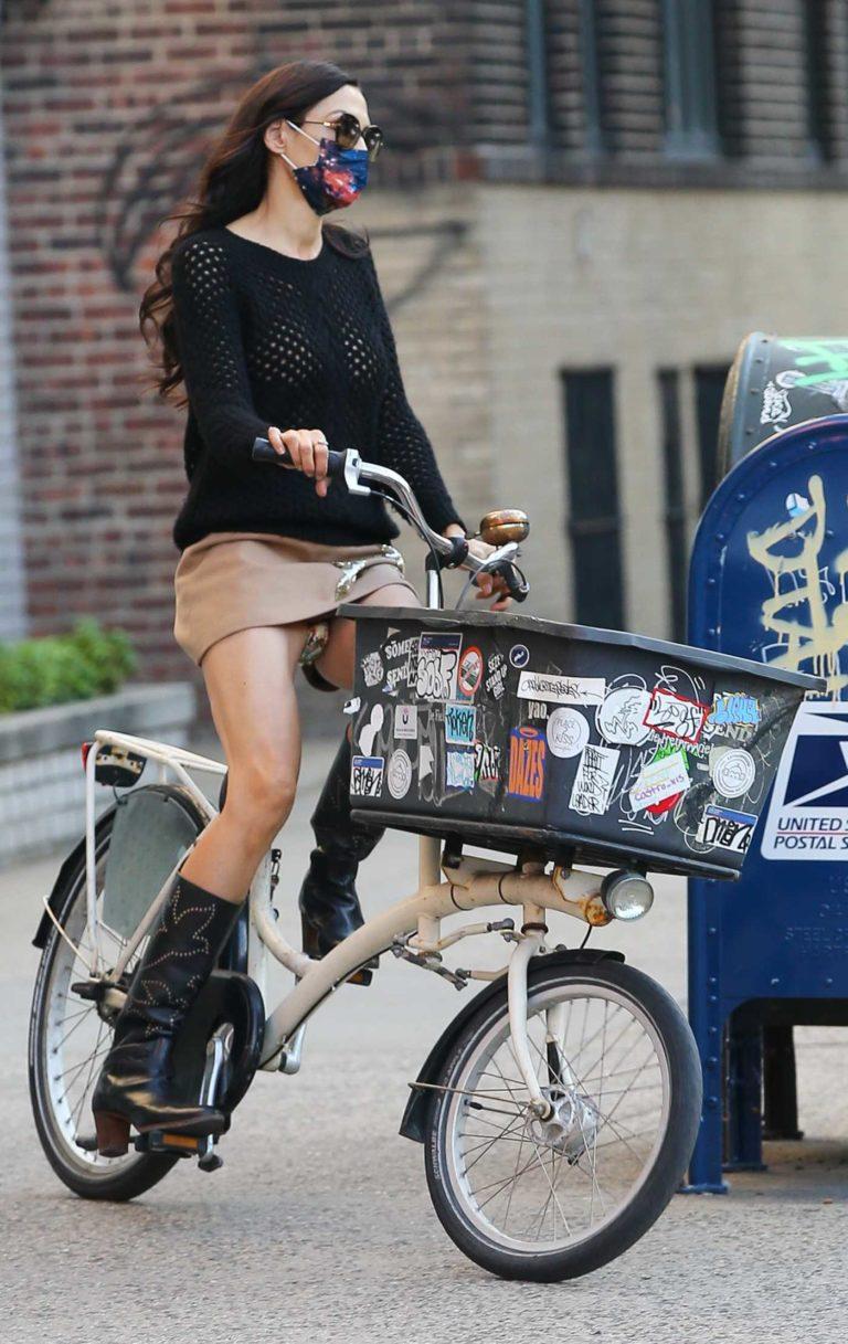 Famke Janssen in a Beige Mini Skirt