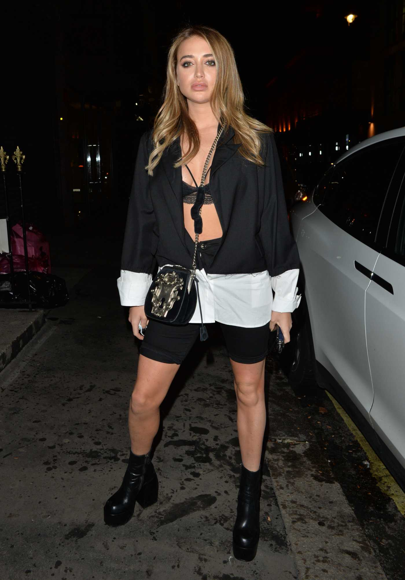 Georgia Harrison in a Black Spandex Shorts Arrives at MKNY House in Mayfair, London 10/23/2020