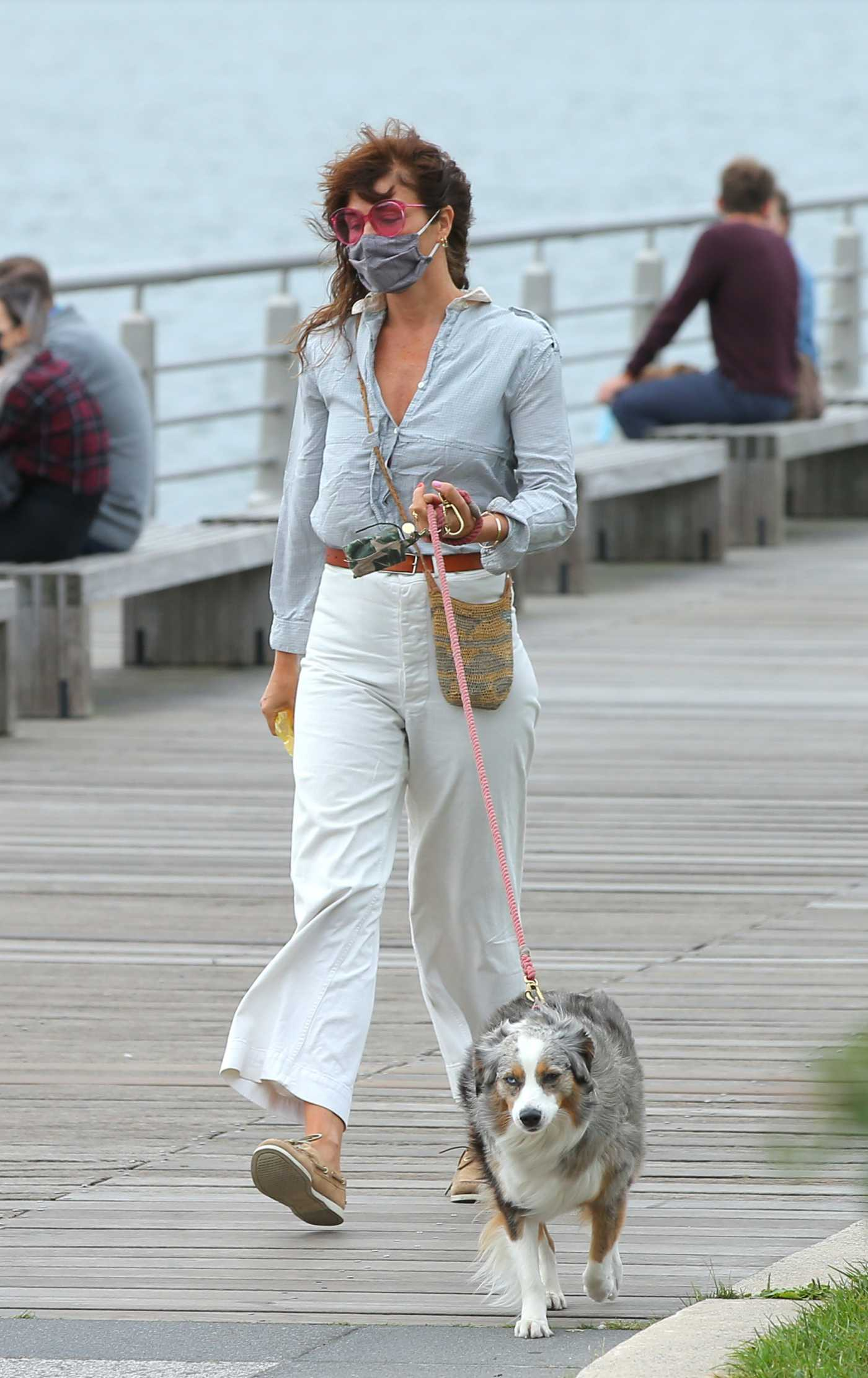 Helena Christensen in a White Pants Walks Her Dog Kuma in New York 10/11/2020