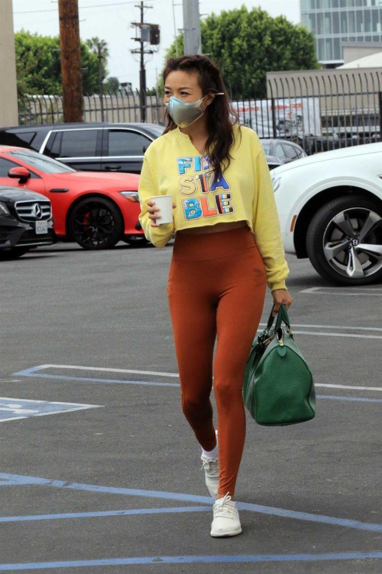 Jeannie Mai in a Yellow Cropped Sweatshirt