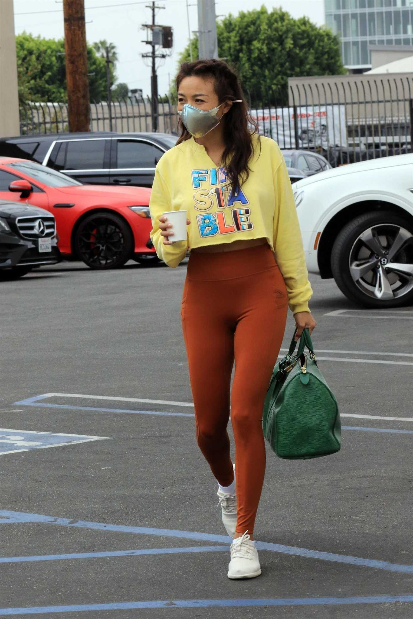 Jeannie Mai in a Yellow Cropped Sweatshirt Leaves the DWTS Studio in Los Angeles 10/23/2020