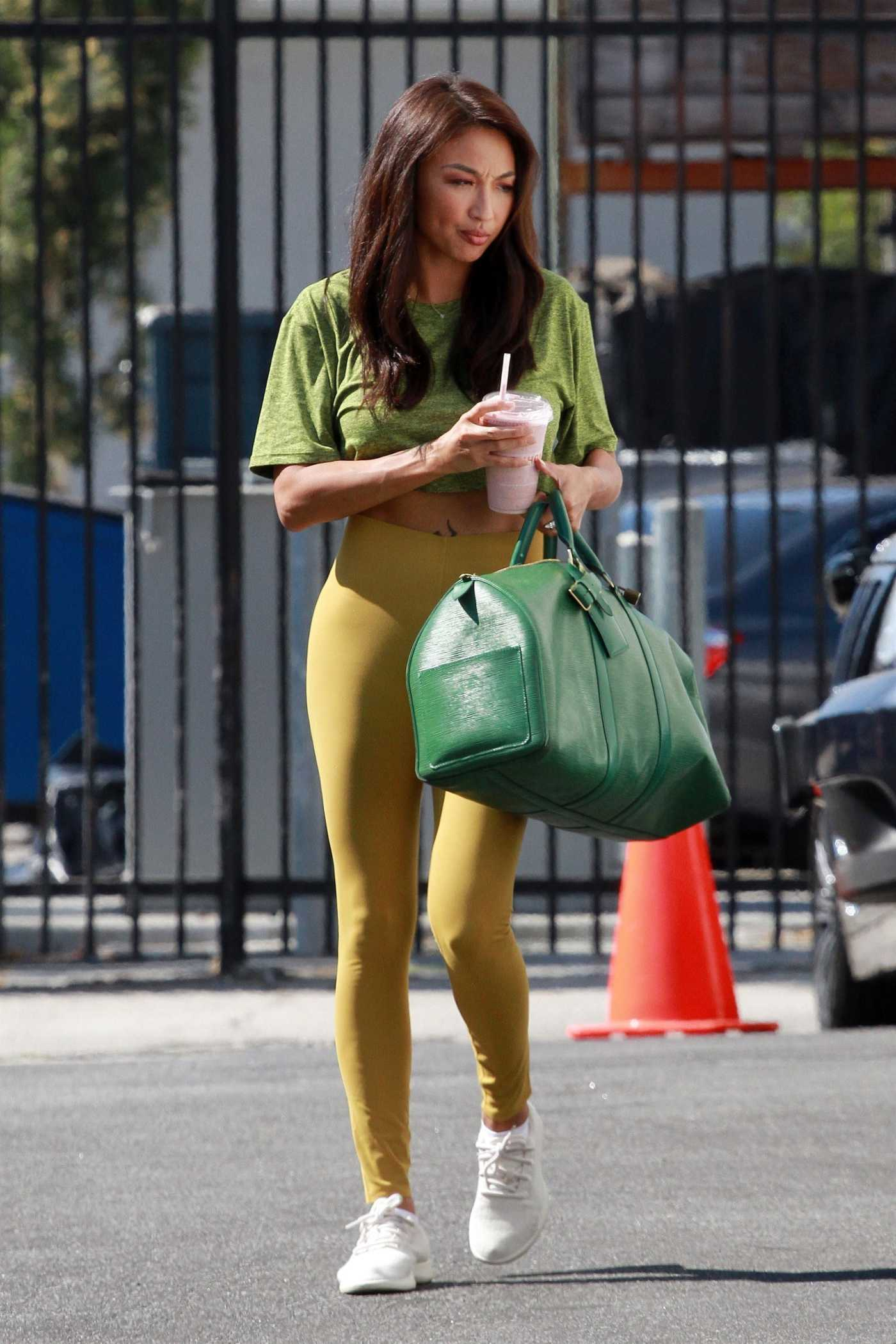 Jeannie Mai in a Yellow Leggings Heads to the DWTS Studio in Los Angeles 10/15/2020