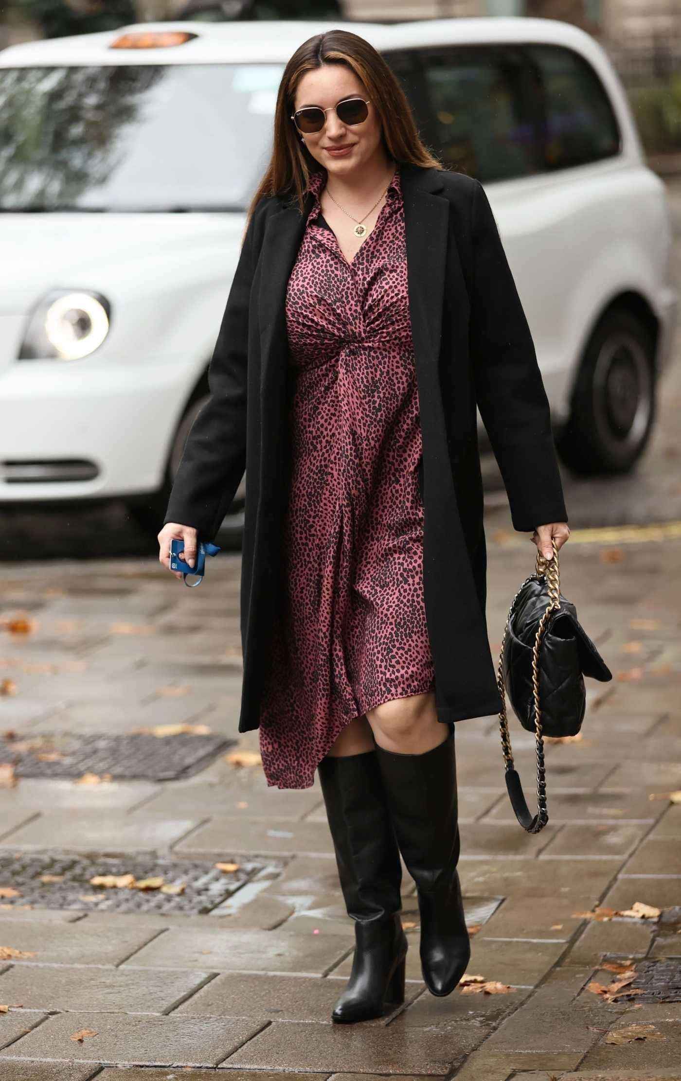 Kelly Brook in a Black Coat Arrives at the Heart Radio in London 10/12/2020
