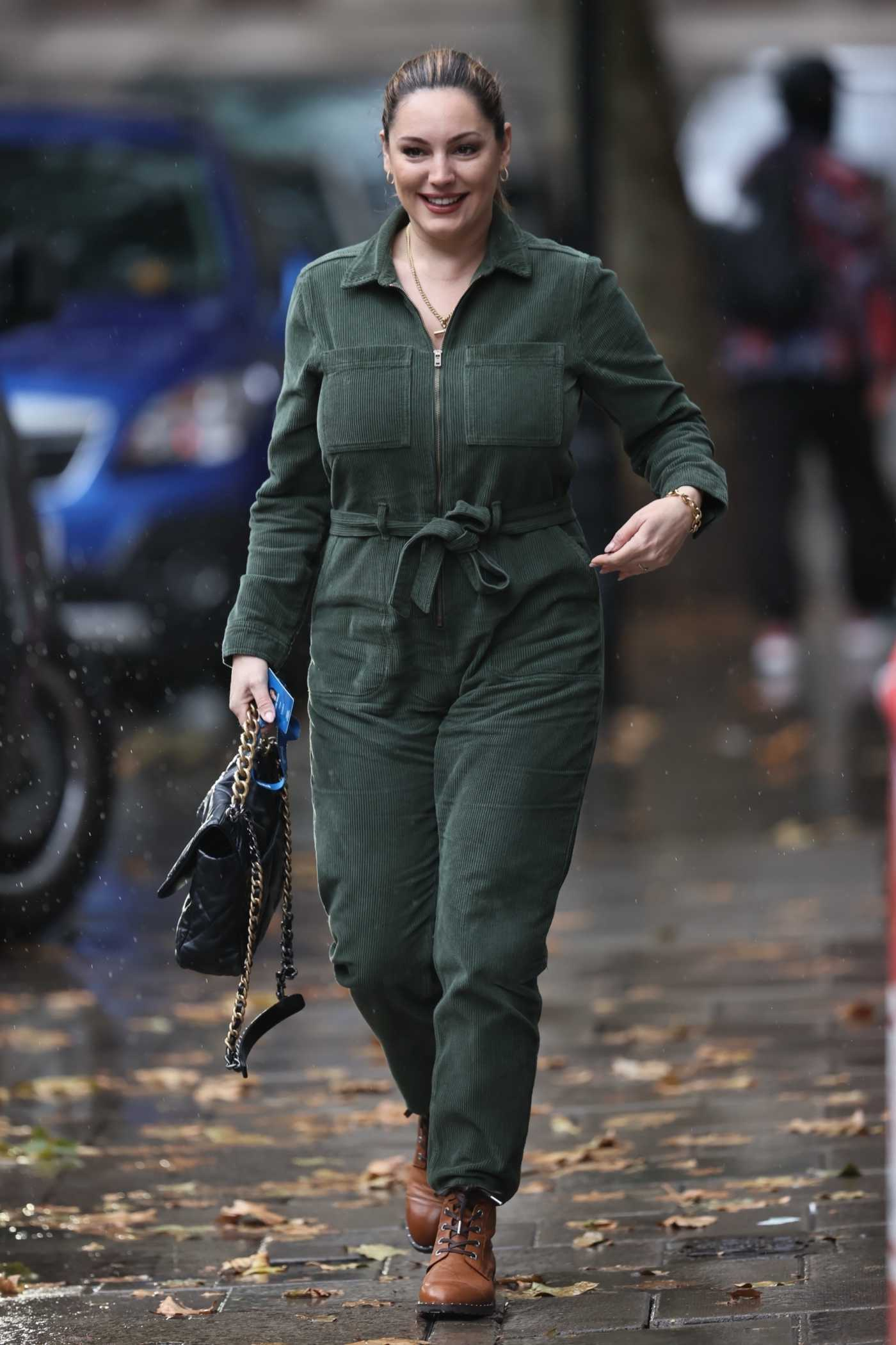 Kelly Brook in a Green Jumpsuit Arrives at the Heart Radio in London 10/09/2020