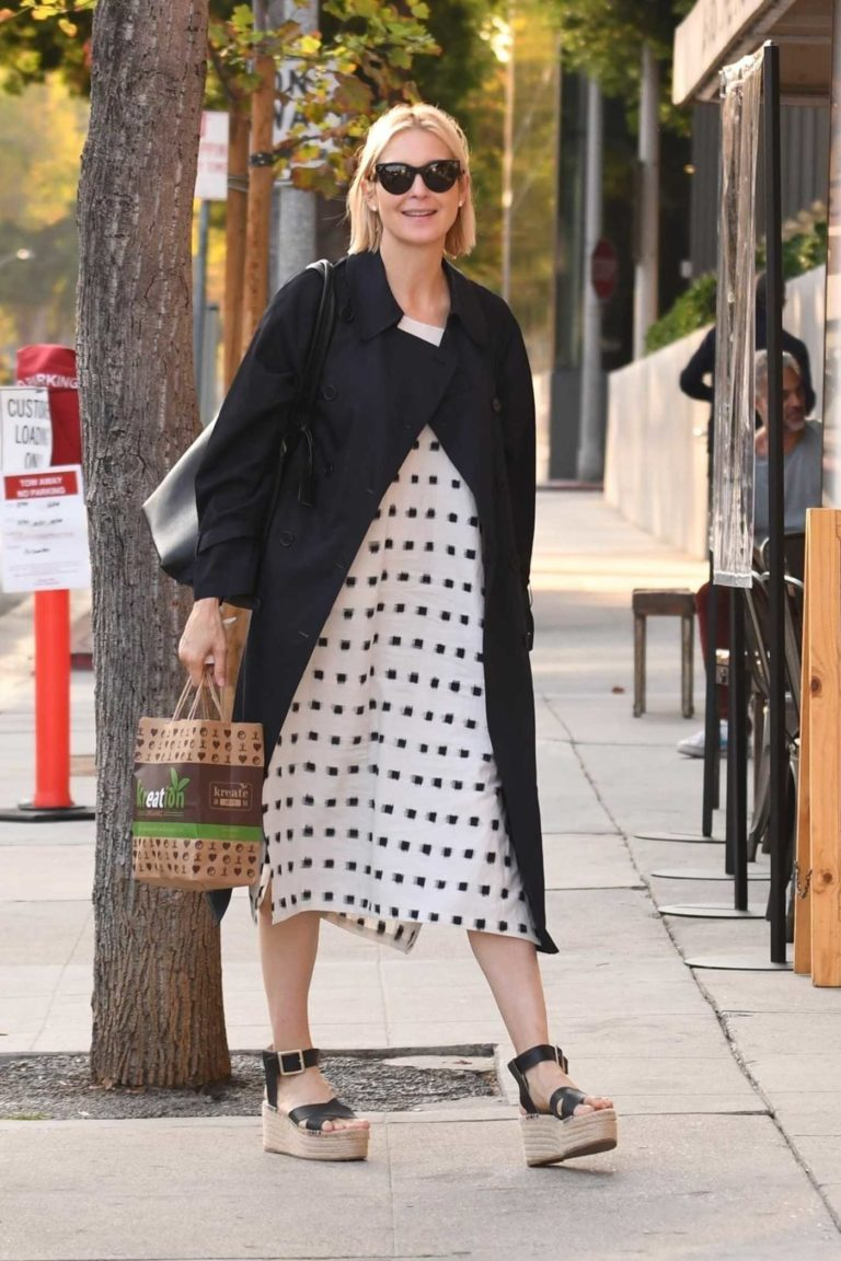 Kelly Rutherford in a Black Trench Coat