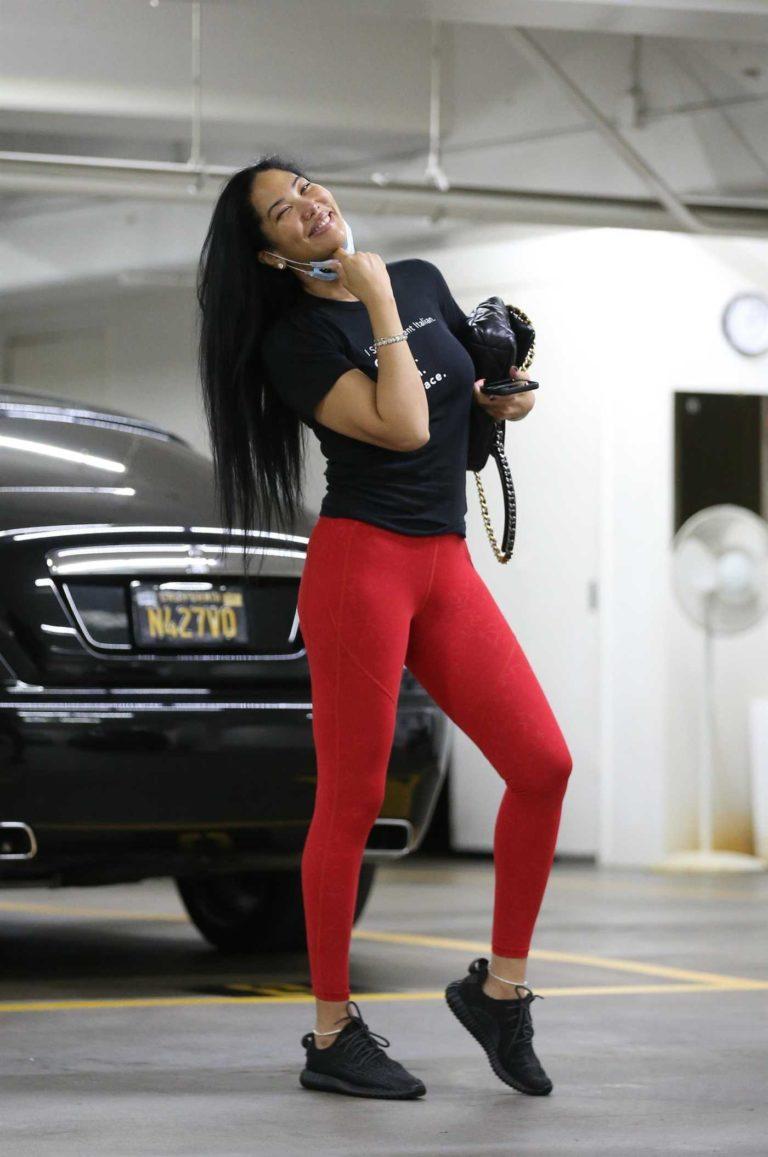 Kimora Lee Simmons in a Red Leggings