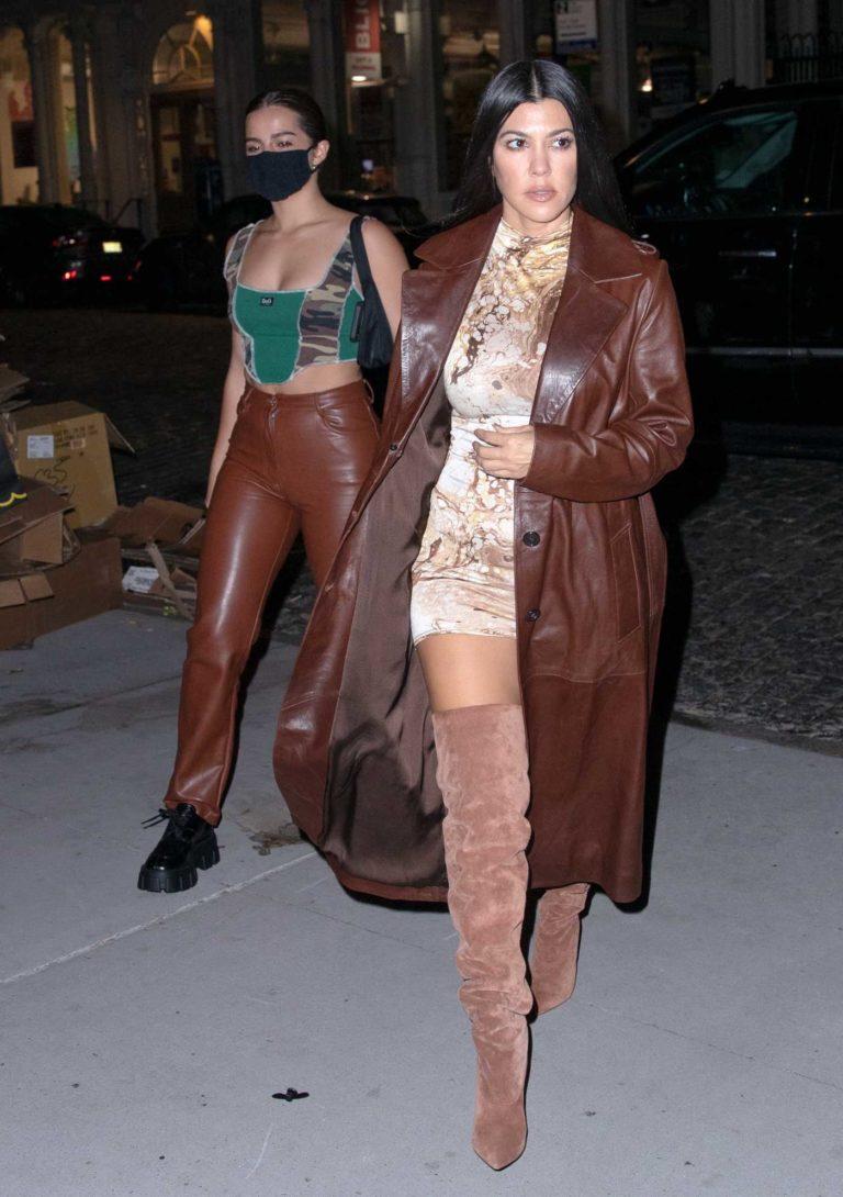 Kourtney Kardashian in a Brown Leather Coat